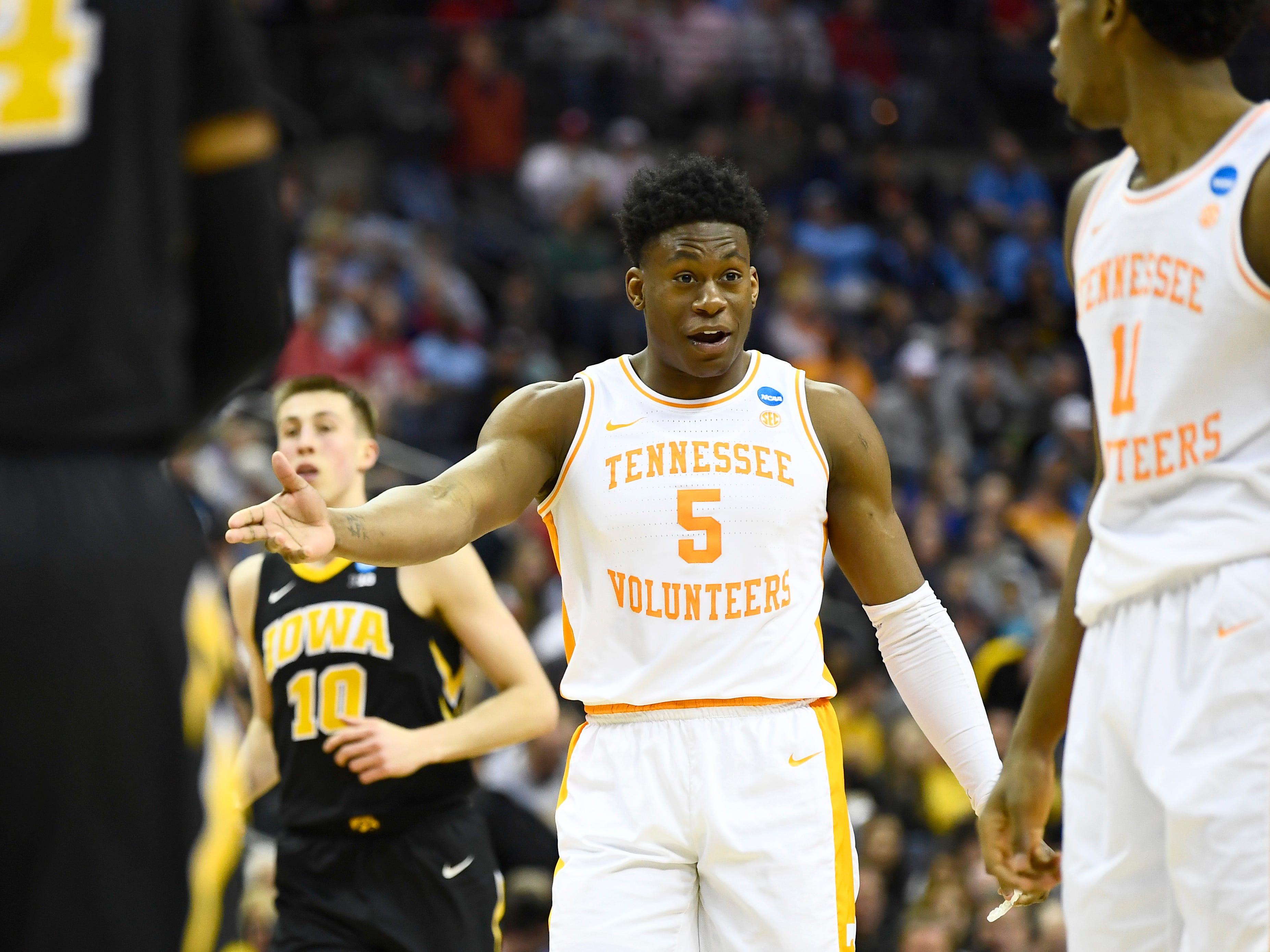 Tennessee guard Admiral Schofield (5) talks to forward Kyle Alexander (11) during the second half of the game against the Iowa Hawkeyes in the second round of the NCAA Tournament at Nationwide Arena in Columbus, Ohio, Sunday, March 24, 2019.