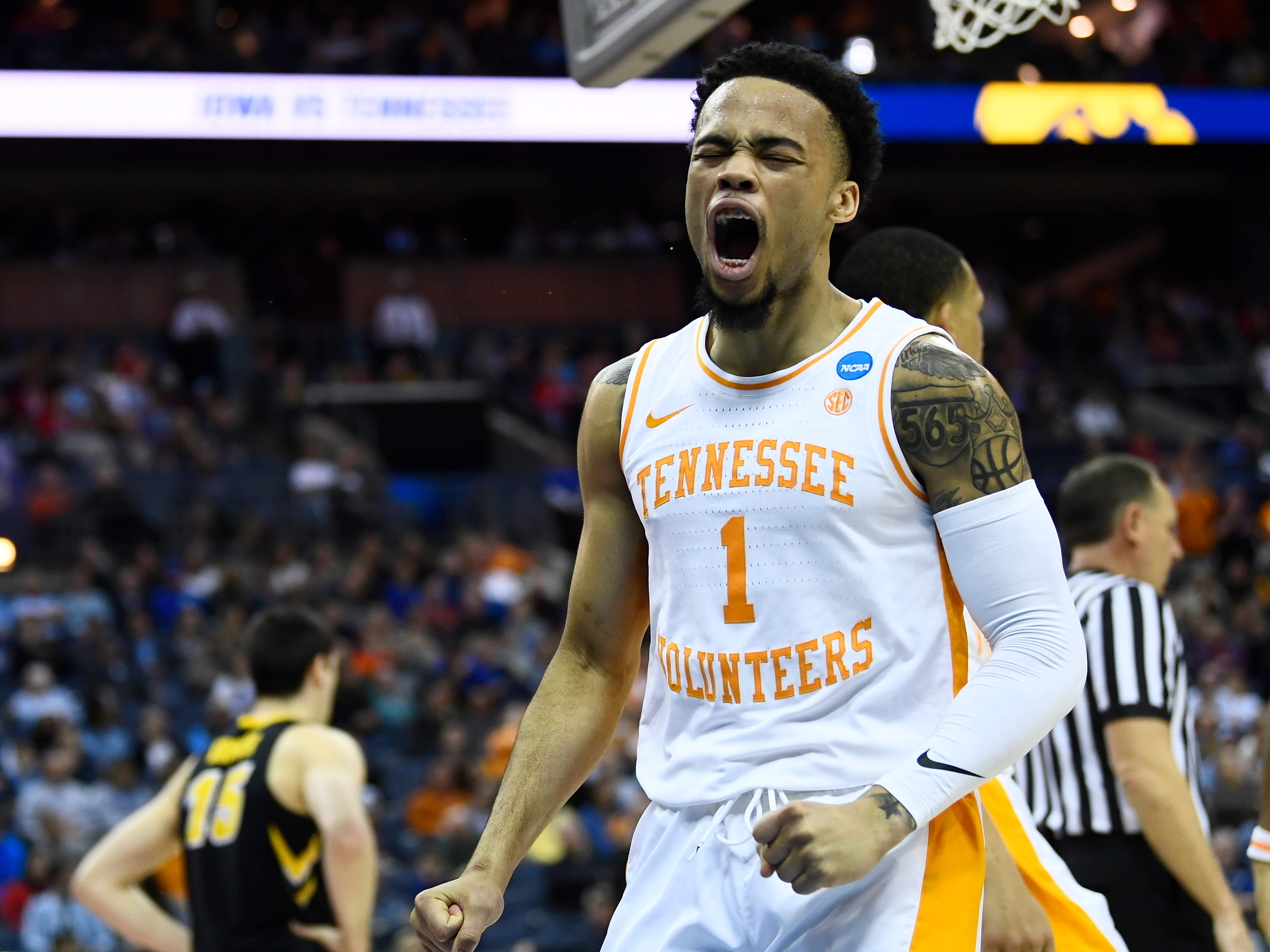Tennessee guard Lamonte Turner (1) celebrates a foul against Iowa during the first half of the game in the second round of the NCAA Tournament at Nationwide Arena in Columbus, Ohio, Sunday, March 24, 2019.