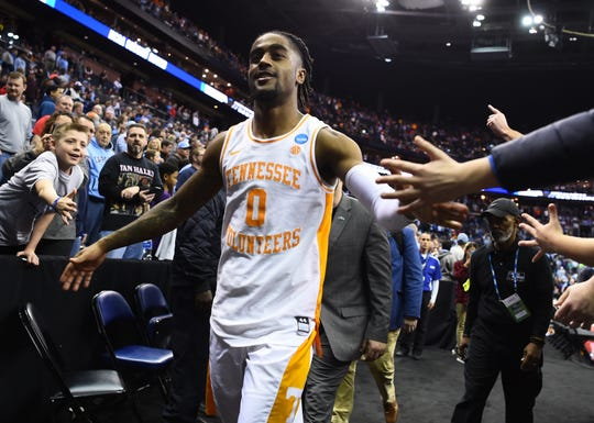 Tennessee guard Jordan Bone (0) celebrates with fans after the team's overtime win over the Iowa Hawkeyes in the second round of the NCAA Tournament at Nationwide Arena in Columbus, Ohio, Sunday, March 24, 2019.