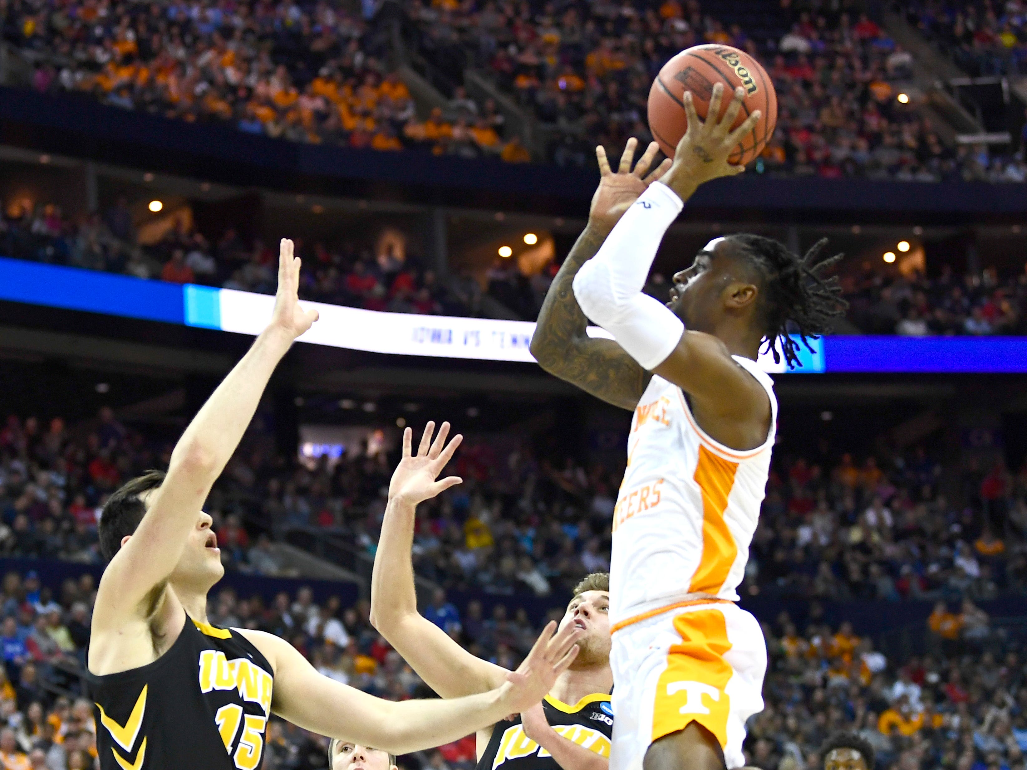 Tennessee guard Jordan Bone (0) shoots over Iowa forward Ryan Kriener (15) and Iowa guard Jordan Bohannon (3) during the first half in the second round of the NCAA Tournament at Nationwide Arena in Columbus, Ohio, Sunday, March 24, 2019.