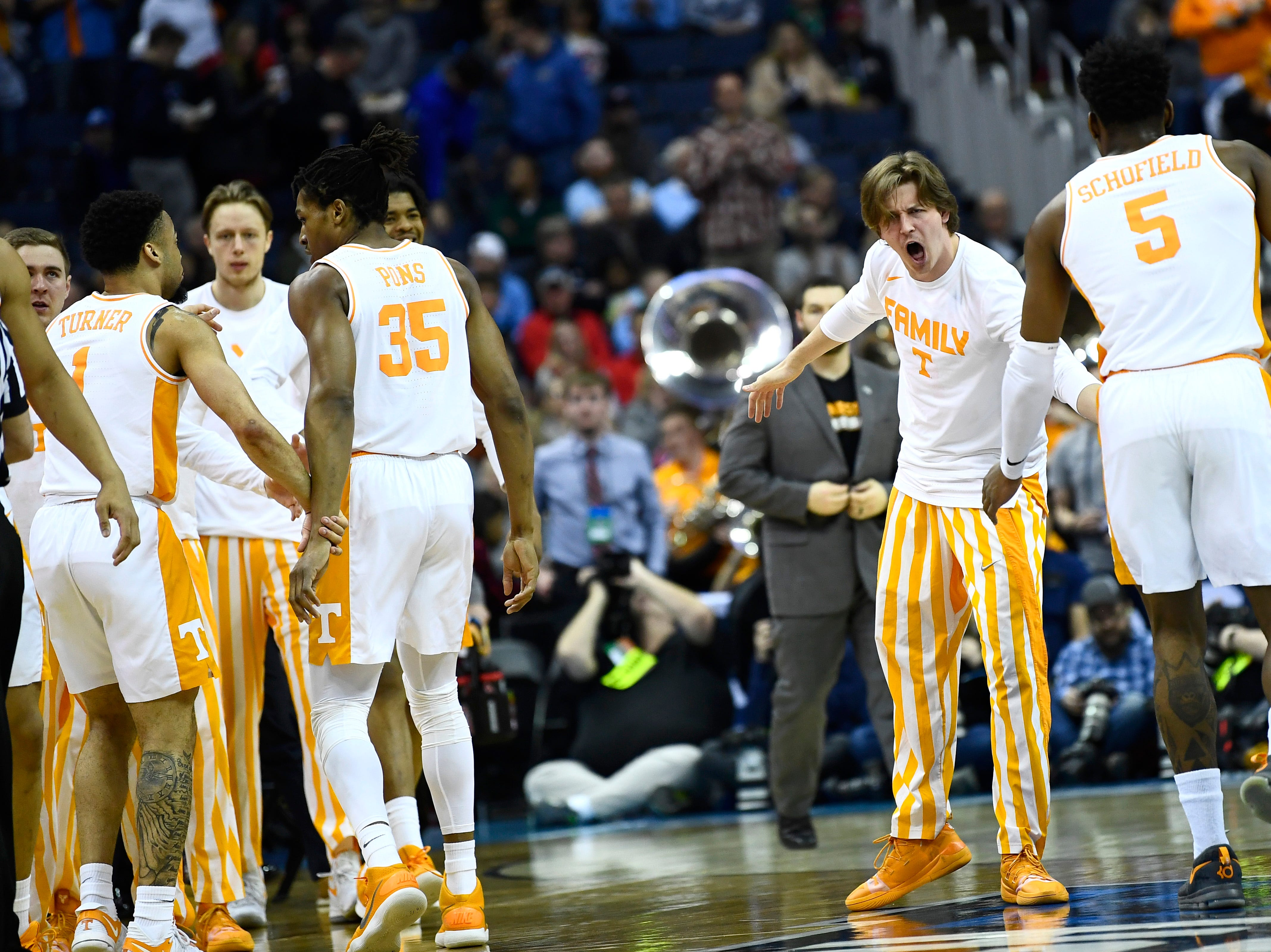 Tennessee guard Admiral Schofield (5) gets high-fived as he comes off the court during a timeout during the first half against the Iowa Hawkeyes in the second round of the NCAA Tournament at Nationwide Arena in Columbus, Ohio, Sunday, March 24, 2019.
