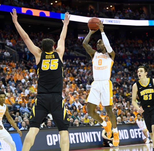 Tennessee guard Jordan Bone (0) shoots against Iowa forward Luka Garza (55) during the first half of the second-round game in the NCAA Tournament at Nationwide Arena in Columbus, Ohio, Sunday, March 24, 2019.