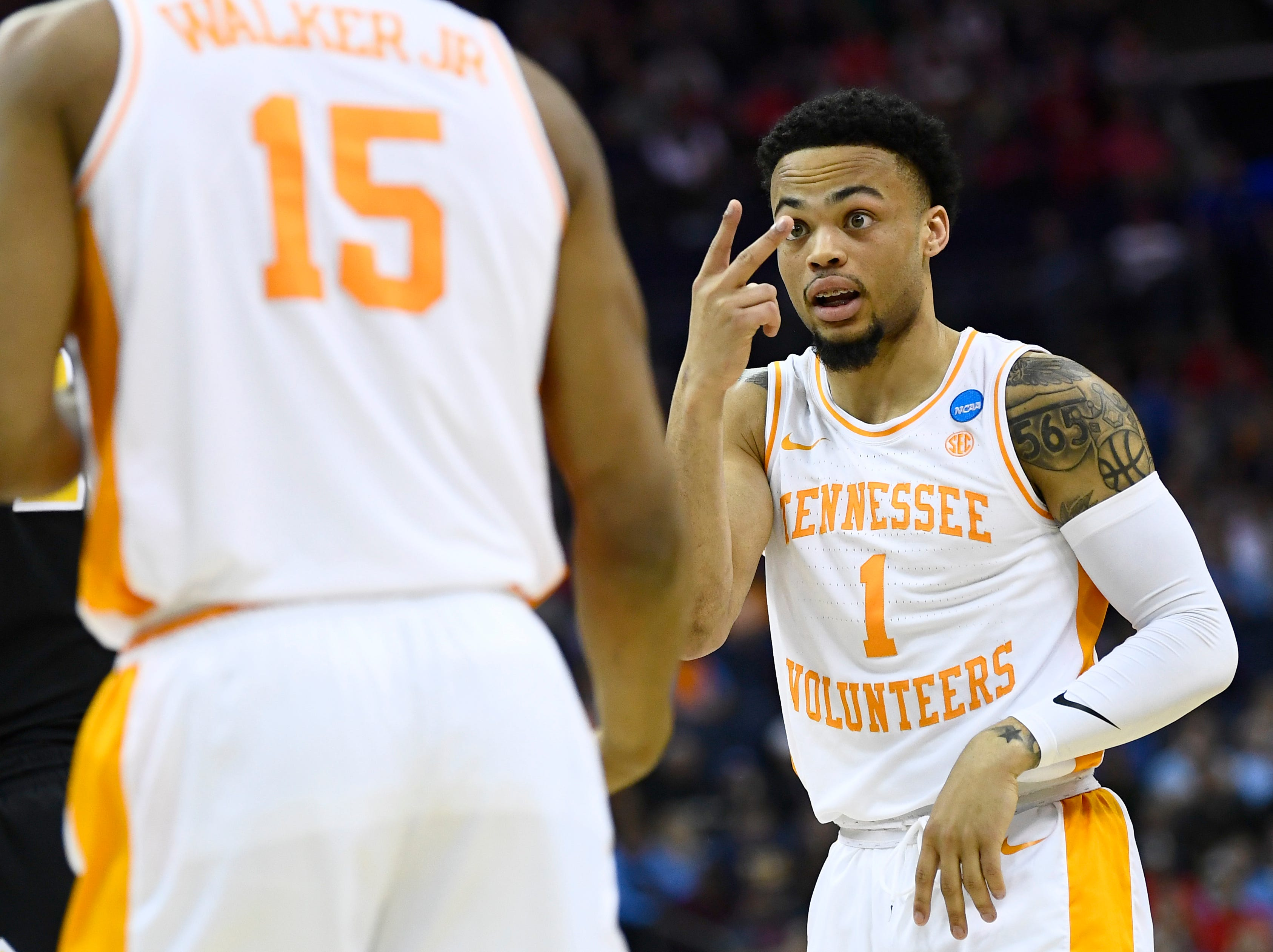 Tennessee guard Lamonte Turner (1) talks to forward Derrick Walker (15) during the first half of the game against the Iowa Hawkeyes in the second round of the NCAA Tournament at Nationwide Arena in Columbus, Ohio, Sunday, March 24, 2019.