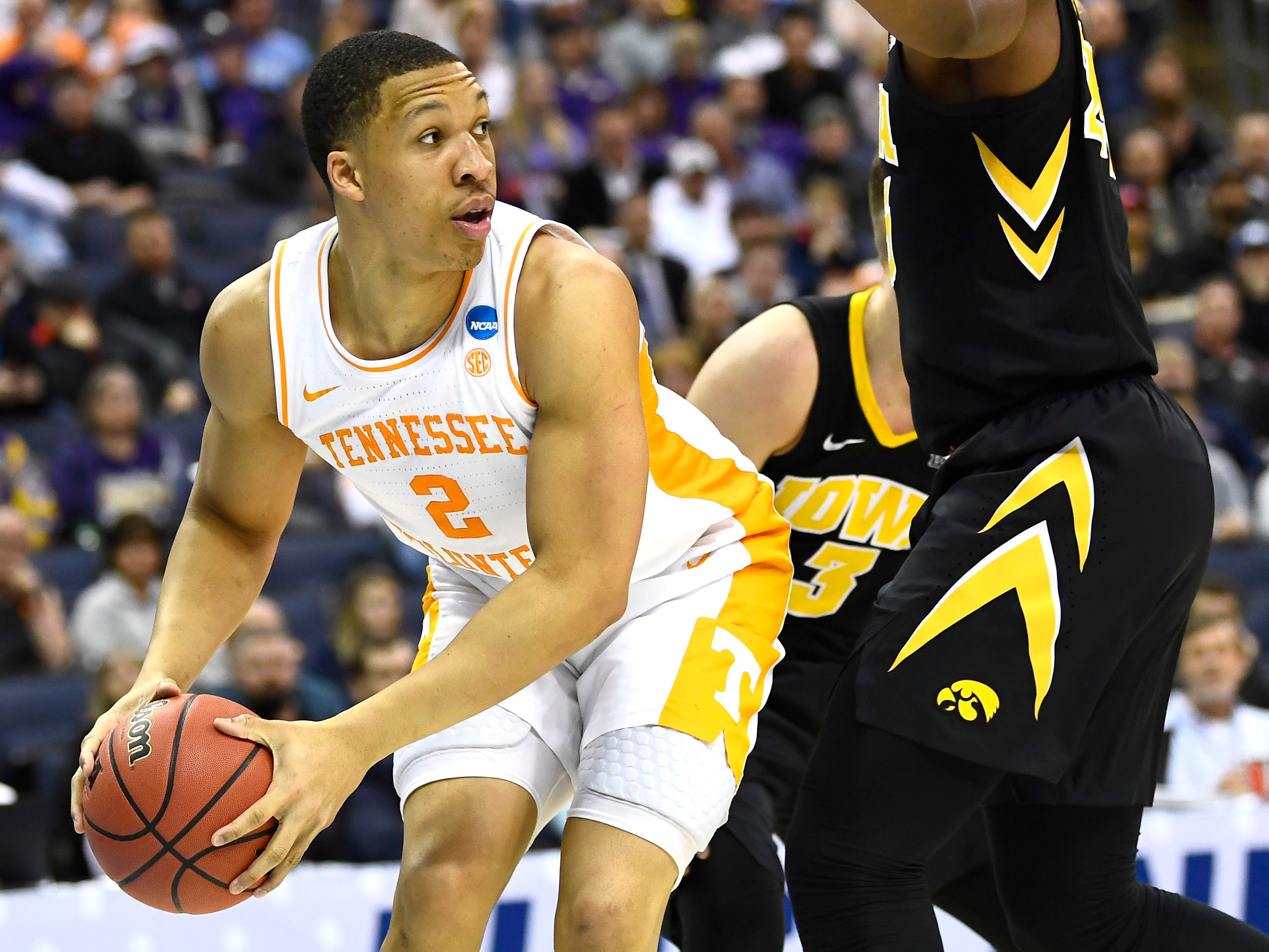 Tennessee forward Grant Williams (2) looks past Iowa forward Tyler Cook (25) for an opening during the second half of the second-round game of the NCAA Tournament at Nationwide Arena in Columbus, Ohio, Sunday, March 24, 2019.