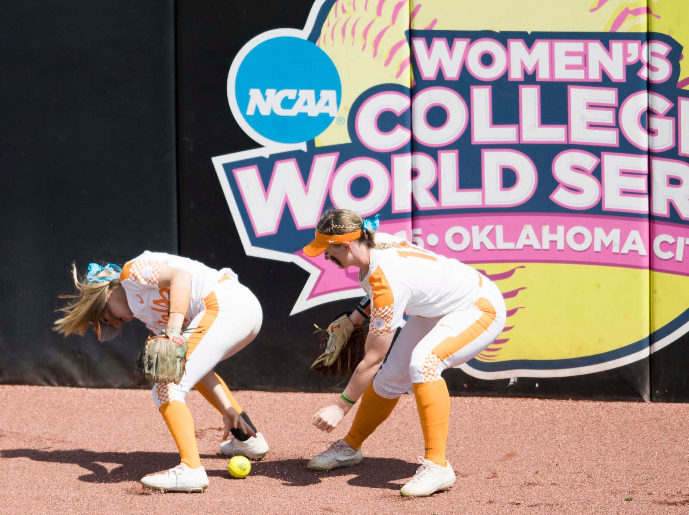 Tennessee outfielder Cailin Hannon (24) and Tennessee outfielder Haley Bearden (11) fumble for the ball during a Lady Vols softball game against Arkansas at Sherri Parker Lee stadium on University of Tennessee's campus in Knoxville Sunday, March 24, 2019. The Lady Vols defeated Arkansas.