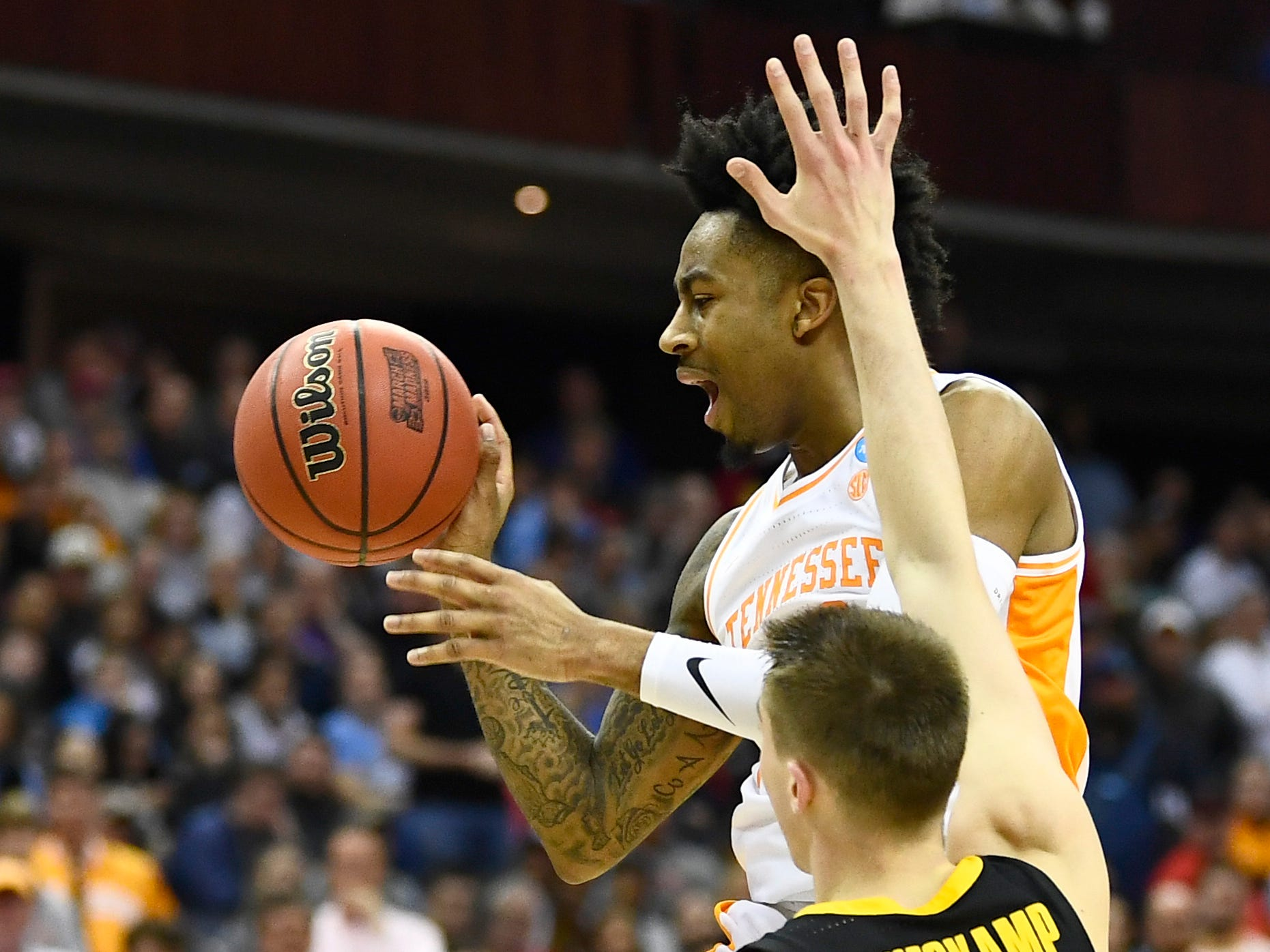 Tennessee guard Jordan Bowden (23) looks to pass the ball defended byIowa guard Joe Wieskamp (10) during the second half in the second-round game of the NCAA Tournament at Nationwide Arena in Columbus, Ohio, Sunday, March 24, 2019.