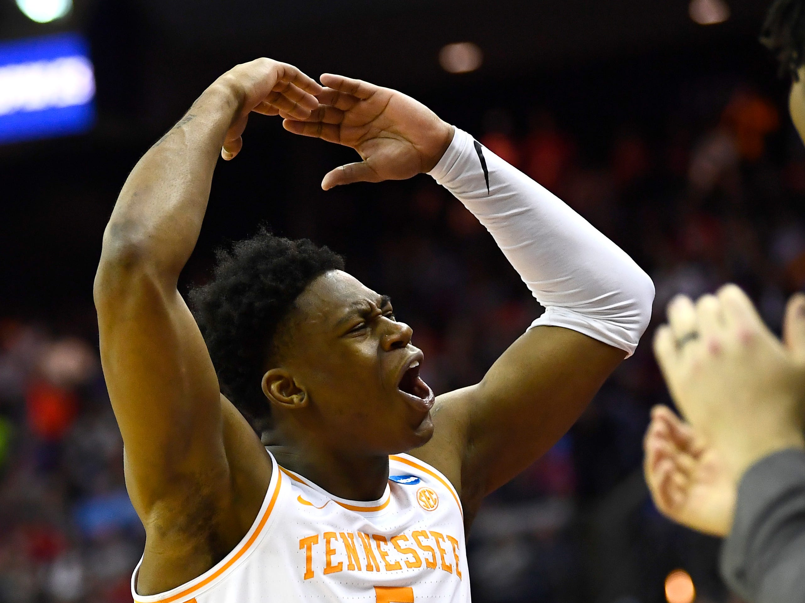 Tennessee guard Admiral Schofield (5) gestures for the crowd to get loud in their overtime win over the Iowa Hawkeyes in the second round of the NCAA Tournament at Nationwide Arena in Columbus, Ohio, Sunday, March 24, 2019.