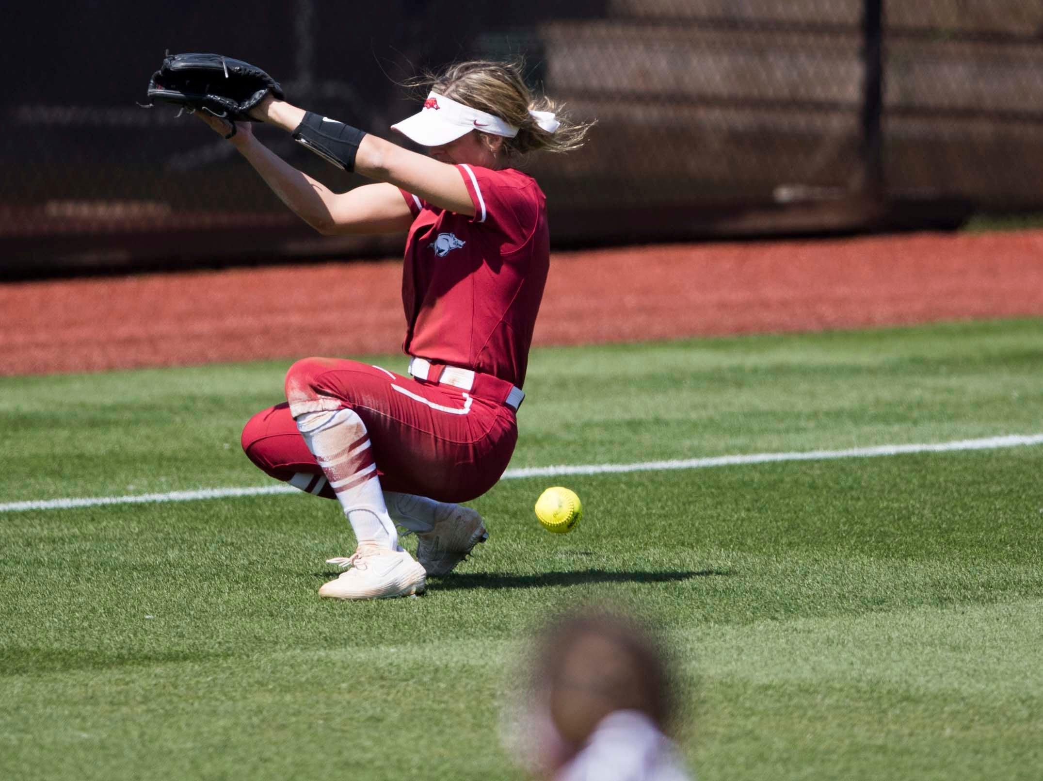 An Arkansas outfielder misses a fly ball during a Lady Vols softball game against Arkansas at Sherri Parker Lee stadium on University of Tennessee's campus in Knoxville Sunday, March 24, 2019. The Lady Vols defeated Arkansas.