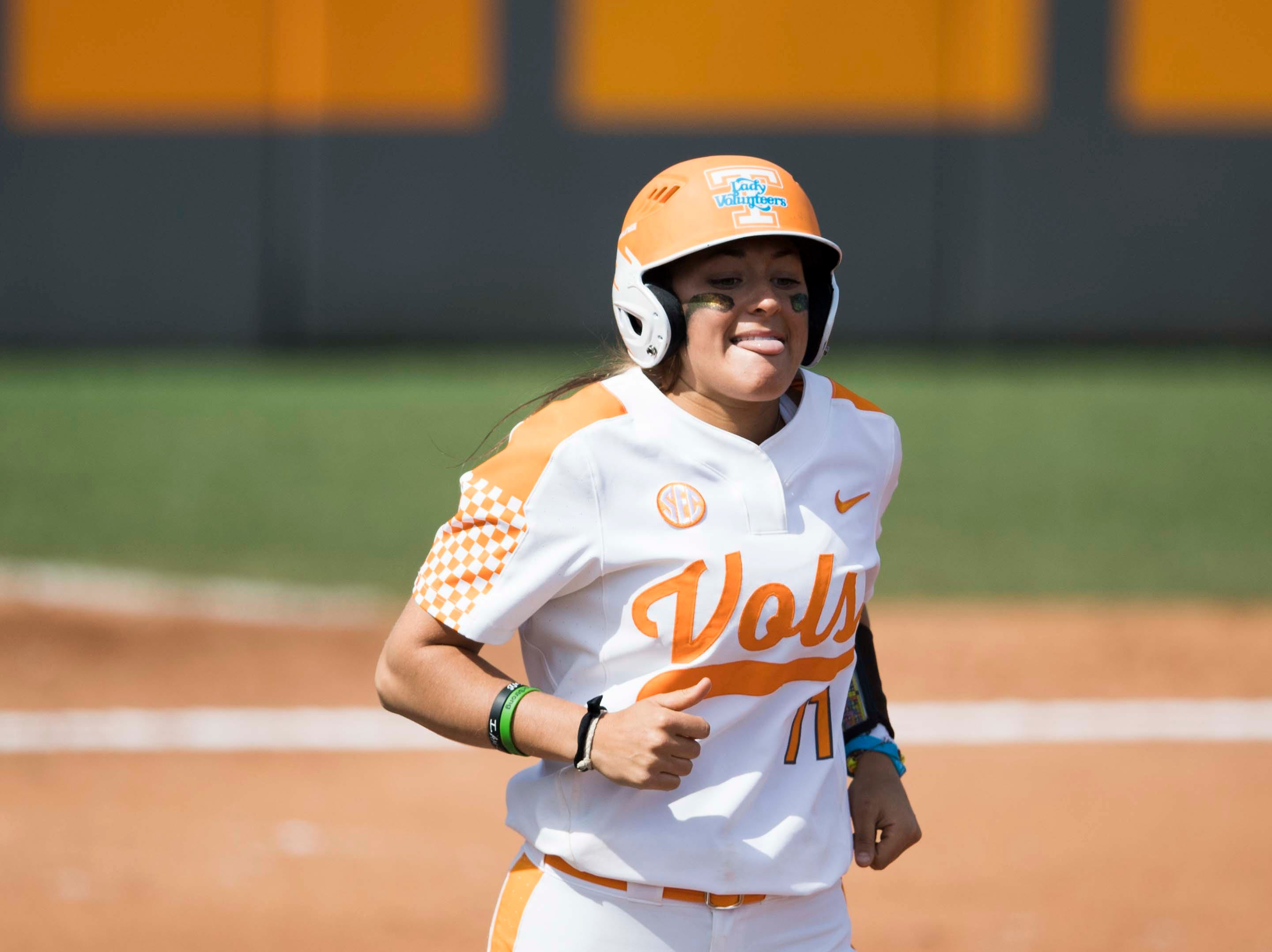 Tennessee infielder Gracie Osbron (77) reacts to getting hit by a pitch as she takes first during a Lady Vols softball game against Arkansas at Sherri Parker Lee stadium on University of Tennessee's campus in Knoxville Sunday, March 24, 2019. The Lady Vols defeated Arkansas.