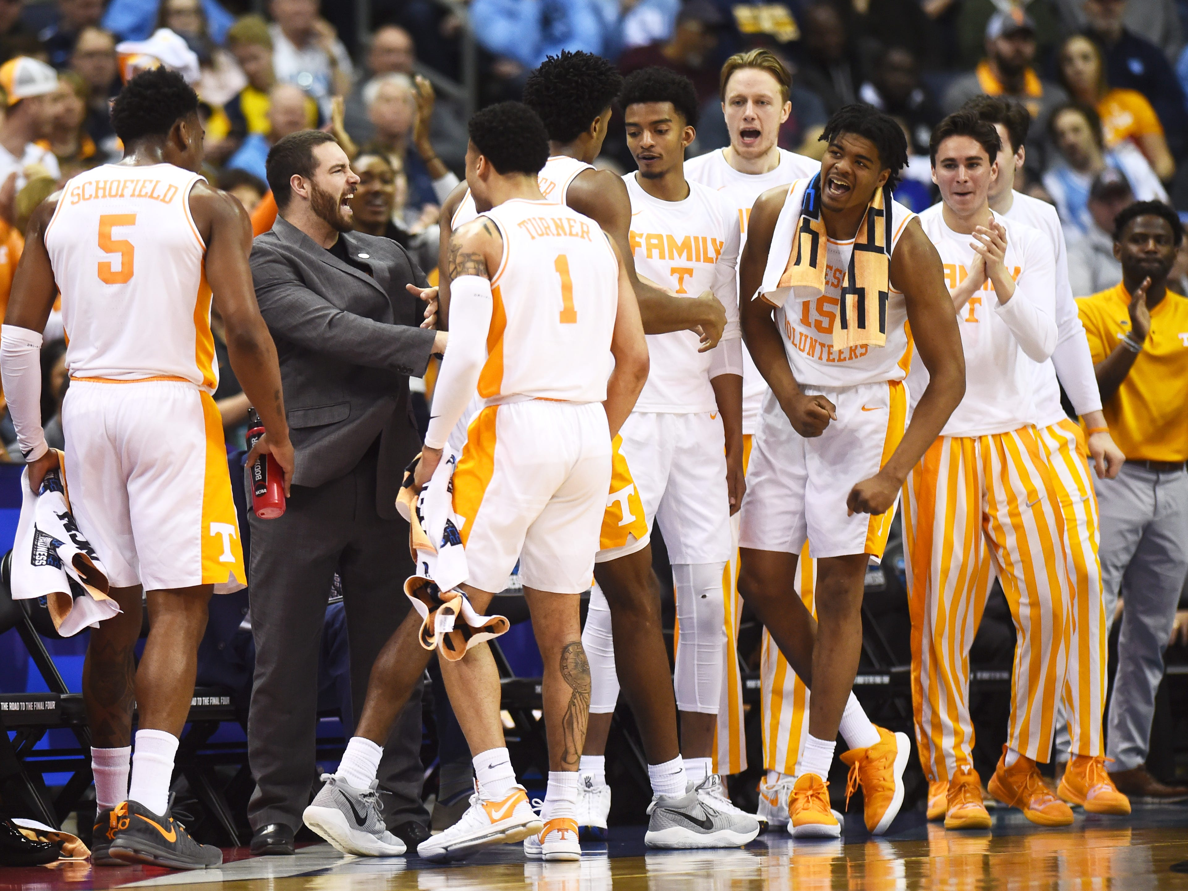 The Tennessee bench celebrates late in the first half of the game against the Iowa Hawkeyes in the second round of the NCAA Tournament at Nationwide Arena in Columbus, Ohio, Sunday, March 24, 2019.