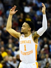 Tennessee guard Lamonte Turner celebrates during overtime of the team's win over the Iowa on Sunday.