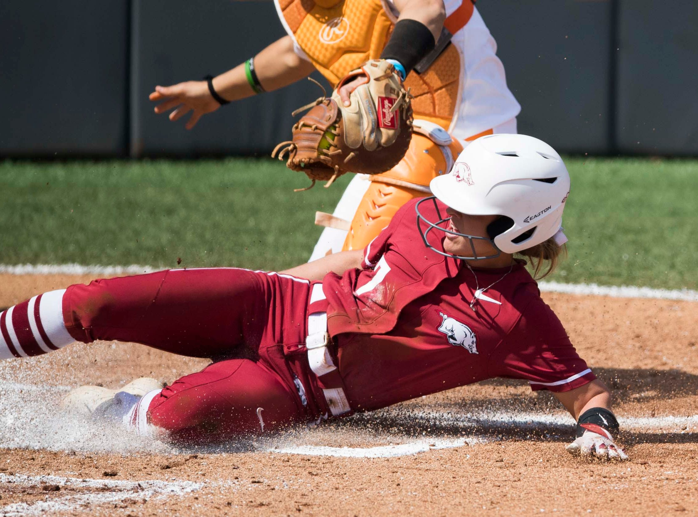 Arkansas' Sydney Parr (7) slides home safely during a Lady Vols softball game against Arkansas at Sherri Parker Lee stadium on University of Tennessee's campus in Knoxville Sunday, March 24, 2019. The Lady Vols defeated Arkansas.