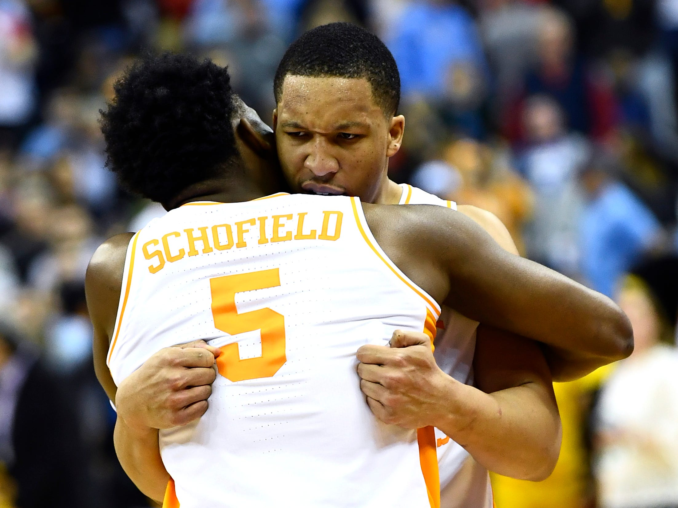 Tennessee guard Admiral Schofield (5) and forward Grant Williams (2) hug after the team's overtime win over the Iowa Hawkeyes in the second round of the NCAA Tournament at Nationwide Arena in Columbus, Ohio, Sunday, March 24, 2019.