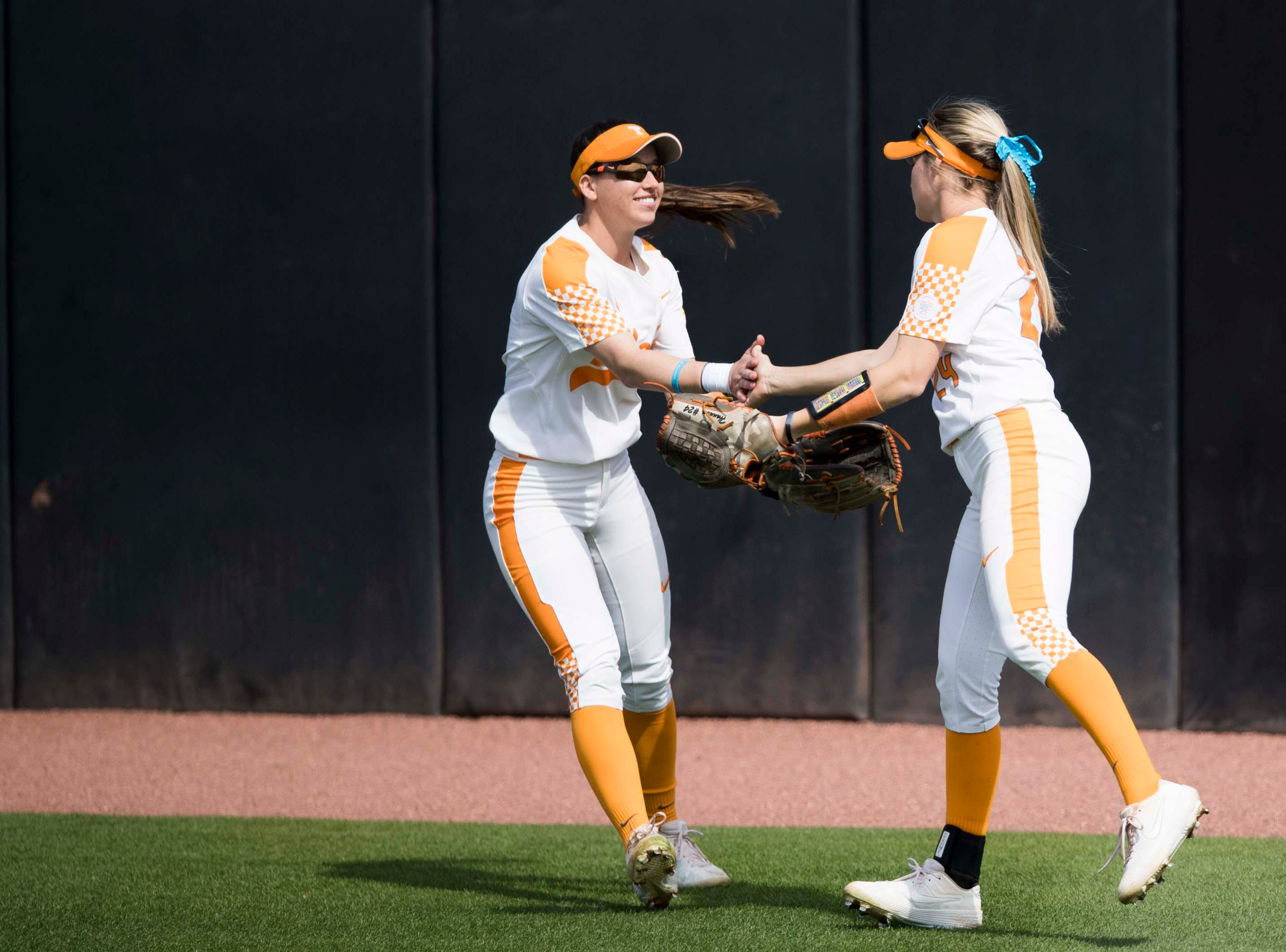 Tennessee outfielder Jenna Holcomb (2) congratulates Tennessee outfielder Cailin Hannon (24) on her catch during a Lady Vols softball game against Arkansas at Sherri Parker Lee stadium on University of Tennessee's campus in Knoxville Sunday, March 24, 2019. The Lady Vols defeated Arkansas.