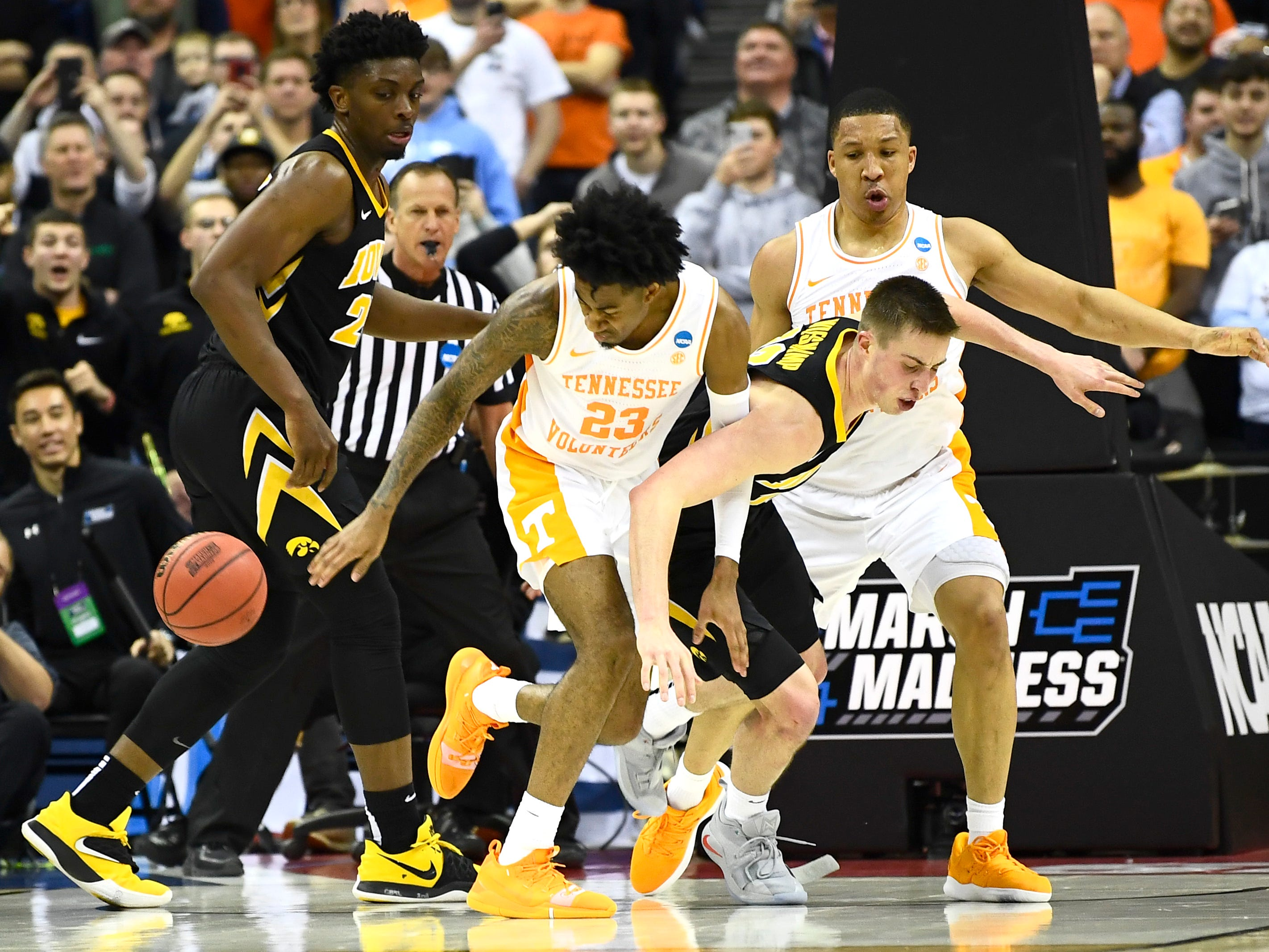 Tennessee guard Jordan Bowden (23) and Iowa guard Joe Wieskamp (10) battle for a rebound during UT's overtime win in the second round of the NCAA Tournament at Nationwide Arena in Columbus, Ohio, Sunday, March 24, 2019.