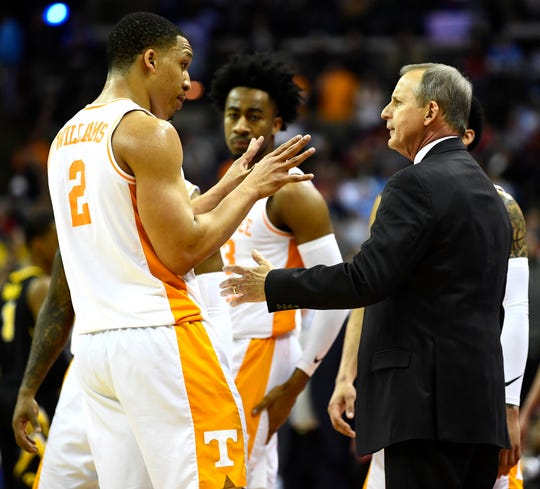 Tennessee forward Grant Williams (2) talks to head coach Rick Barnes during a timeout in the overtime win over  the Iowa Hawkeyes in the second round of the NCAA Tournament at Nationwide Arena in Columbus, Ohio, Sunday, March 24, 2019.