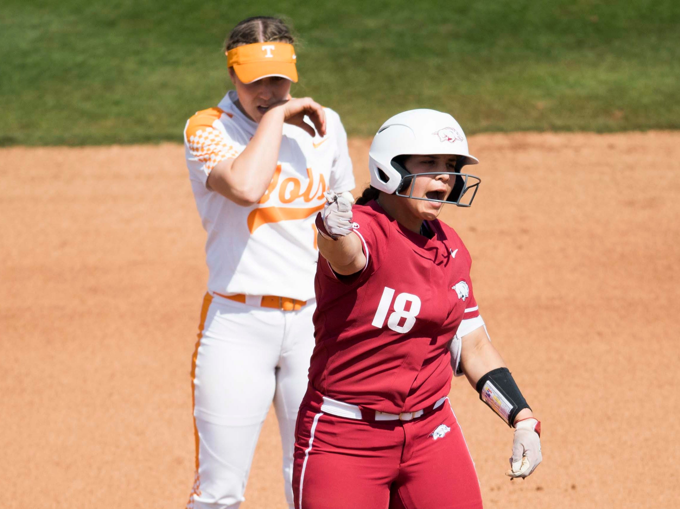Arkansas' Ashley Diaz (18) celebrates a double from second base during a Lady Vols softball game against Arkansas at Sherri Parker Lee stadium on University of Tennessee's campus in Knoxville Sunday, March 24, 2019. The Lady Vols defeated Arkansas.