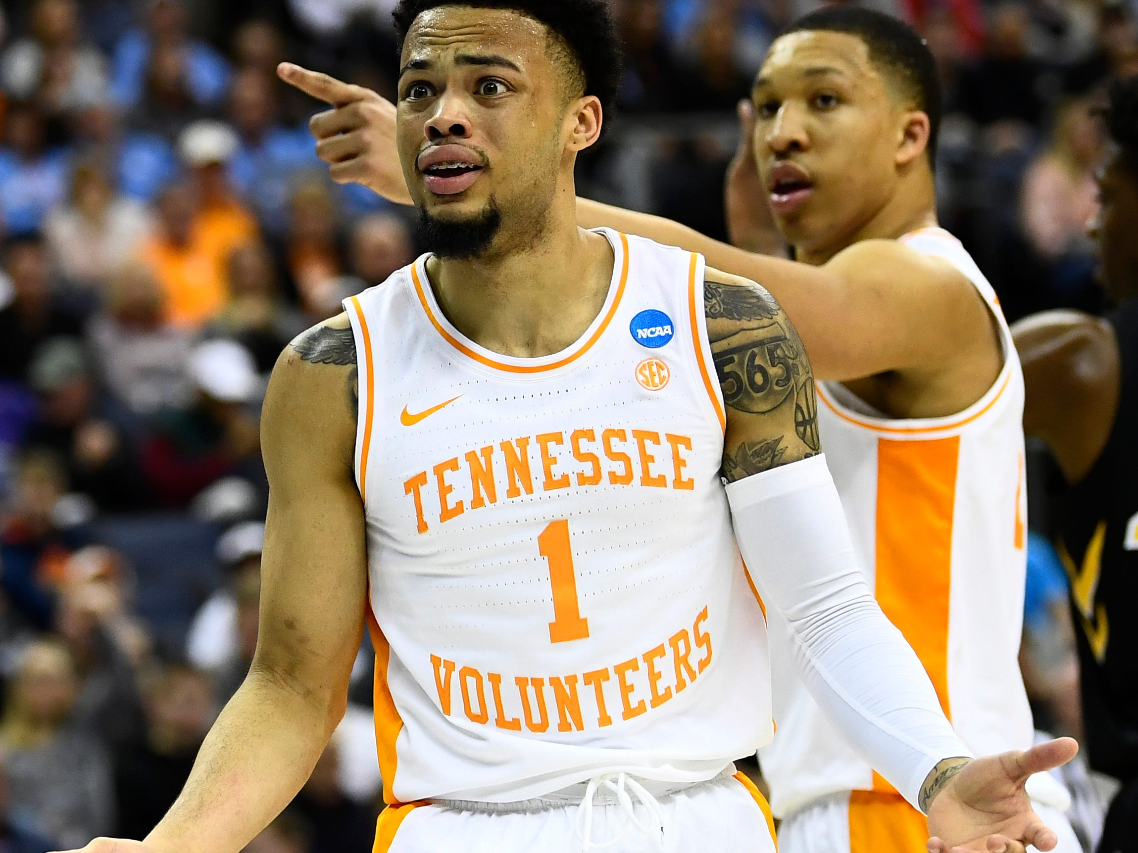 Tennessee guard Lamonte Turner (1) and Tennessee forward Grant Williams (2) look to the referees for a foul call against Iowa during the second half in the second round of the NCAA Tournament at Nationwide Arena in Columbus, Ohio, Sunday, March 24, 2019.