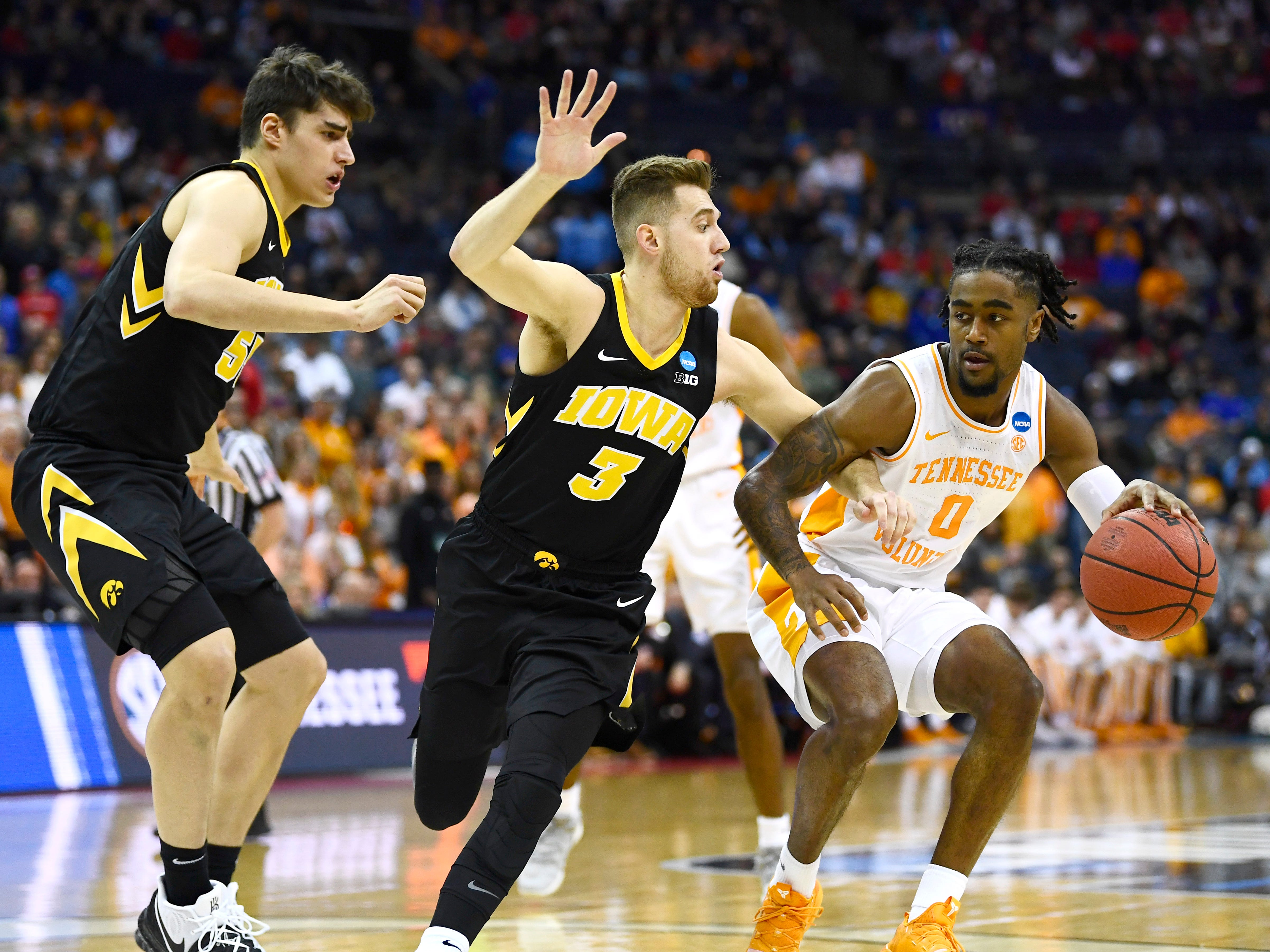 Tennessee guard Jordan Bone (0) drives on Iowa guard Jordan Bohannon (3) during the first half of the Tennessee VolunteersÕ basketball game against the Iowa Hawkeyes in the second round of the NCAA Tournament at Nationwide Arena in Columbus, Ohio, Sunday, March 24, 2019.