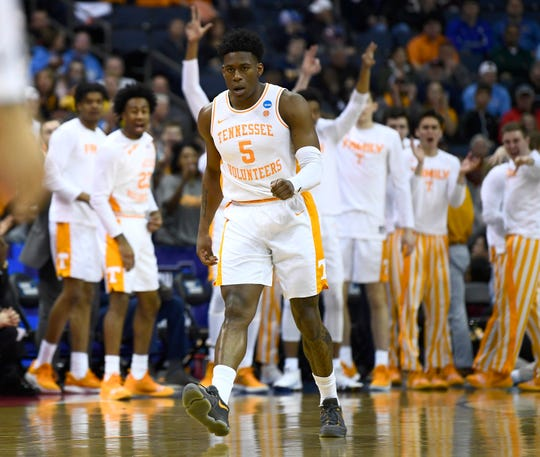 The Tennessee bench celebrates a 3-pointer by guard Admiral Schofield (5) during the first half Sunday.