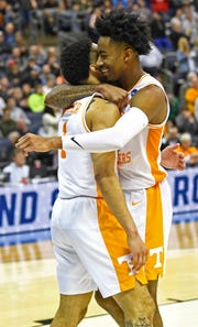 Tennessee guard Lamonte Turner (1) and guard Jordan Bowden (23) celebrate their overtime win over the Iowa Hawkeyes in the second round of the NCAA Tournament at Nationwide Arena in Columbus, Ohio, Sunday, March 24, 2019.