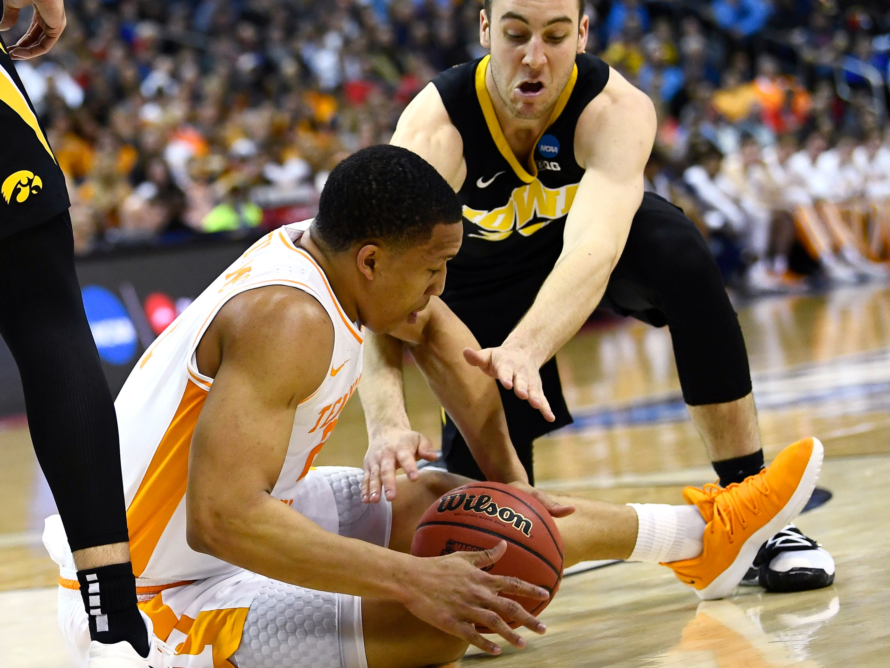 Tennessee forward Grant Williams (2) and Iowa guard Connor McCaffery (30) fight for a loose ball during the first half of the second-round game in the NCAA Tournament at Nationwide Arena in Columbus, Ohio, Sunday, March 24, 2019.