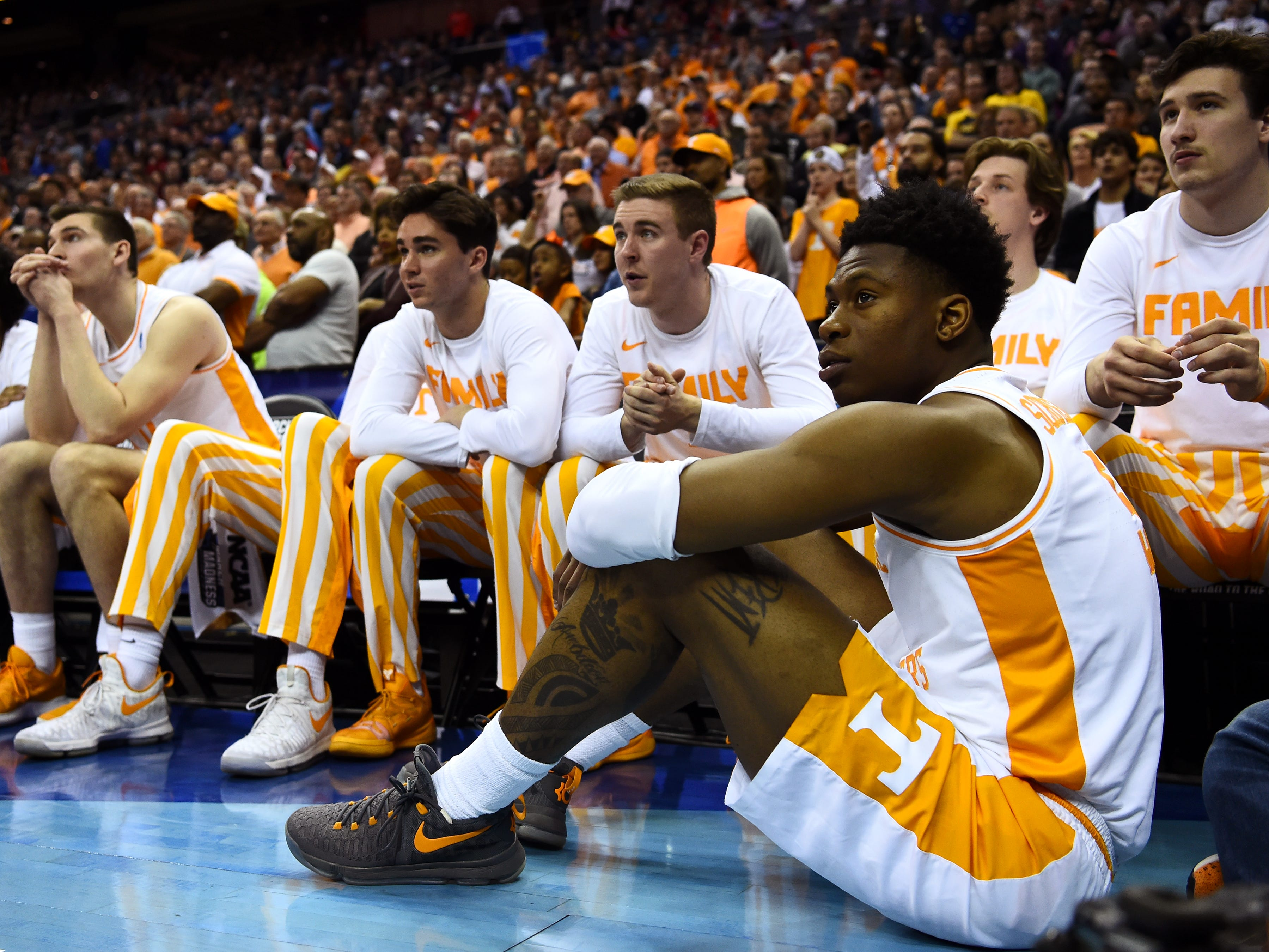 Tennessee guard Admiral Schofield (5) sits on the front in front of the Tennessee bench during overtime of the Tennessee VolunteersÕ basketball game against the Iowa Hawkeyes in the second round of the NCAA Tournament held at Nationwide Arena in Columbus, Ohio, on Sunday, March 24, 2019.
