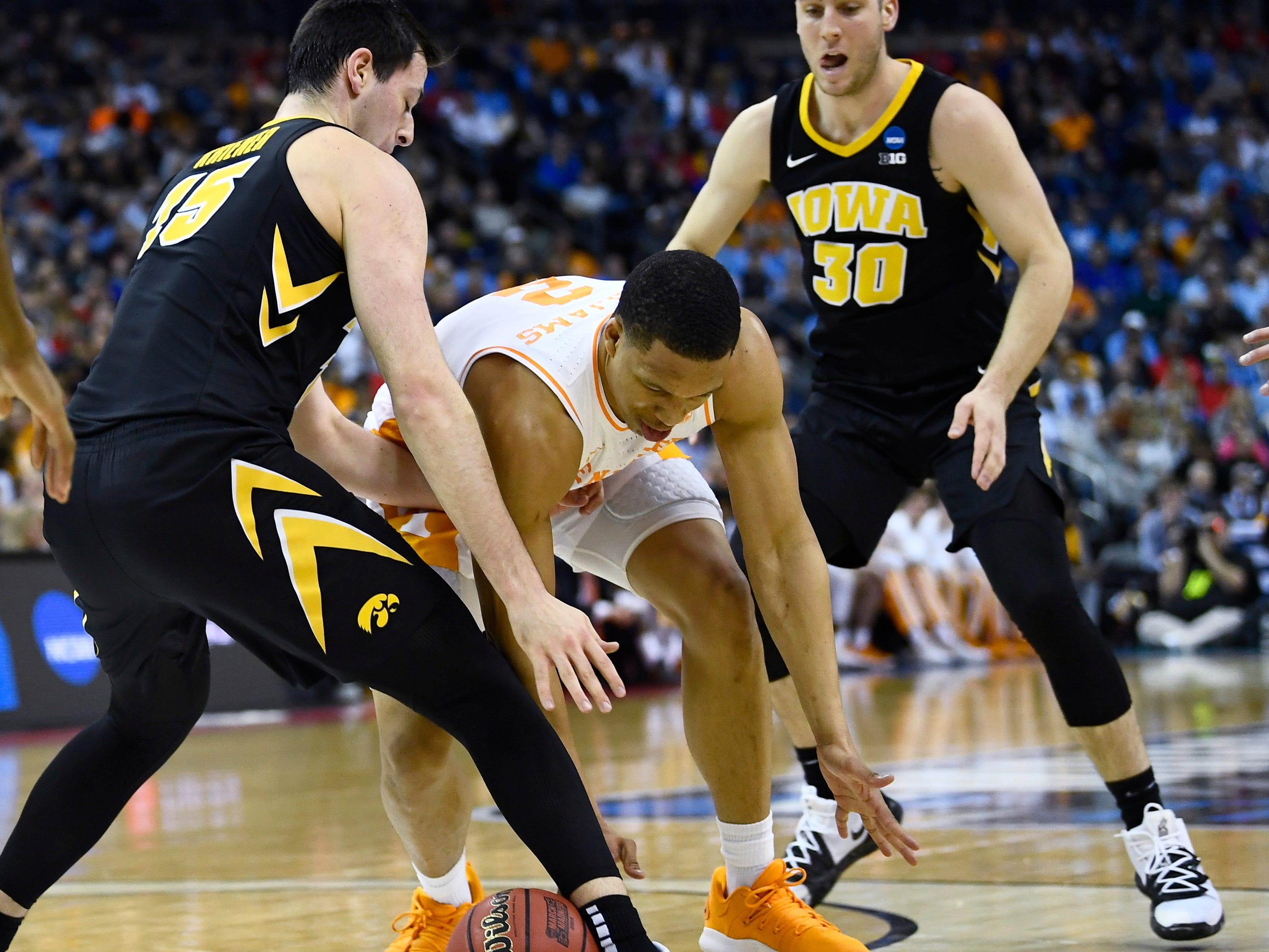 Tennessee forward Grant Williams (2) goes after a loose ball between Iowa forward Ryan Kriener (15) and guard Connor McCaffery (30) during the first half of the game in the second round of the NCAA Tournament at Nationwide Arena in Columbus, Ohio, Sunday, March 24, 2019.