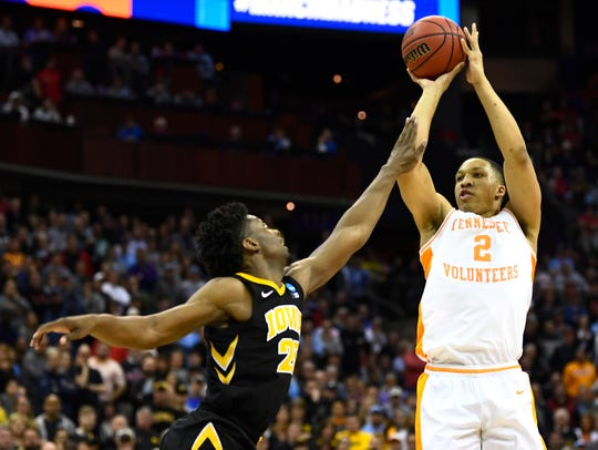 Tennessee forward Grant Williams (2) shoots over Iowa forward Tyler Cook (25) during UT's overtime win in the second round of the NCAA Tournament at Nationwide Arena in Columbus, Ohio, Sunday, March 24, 2019.