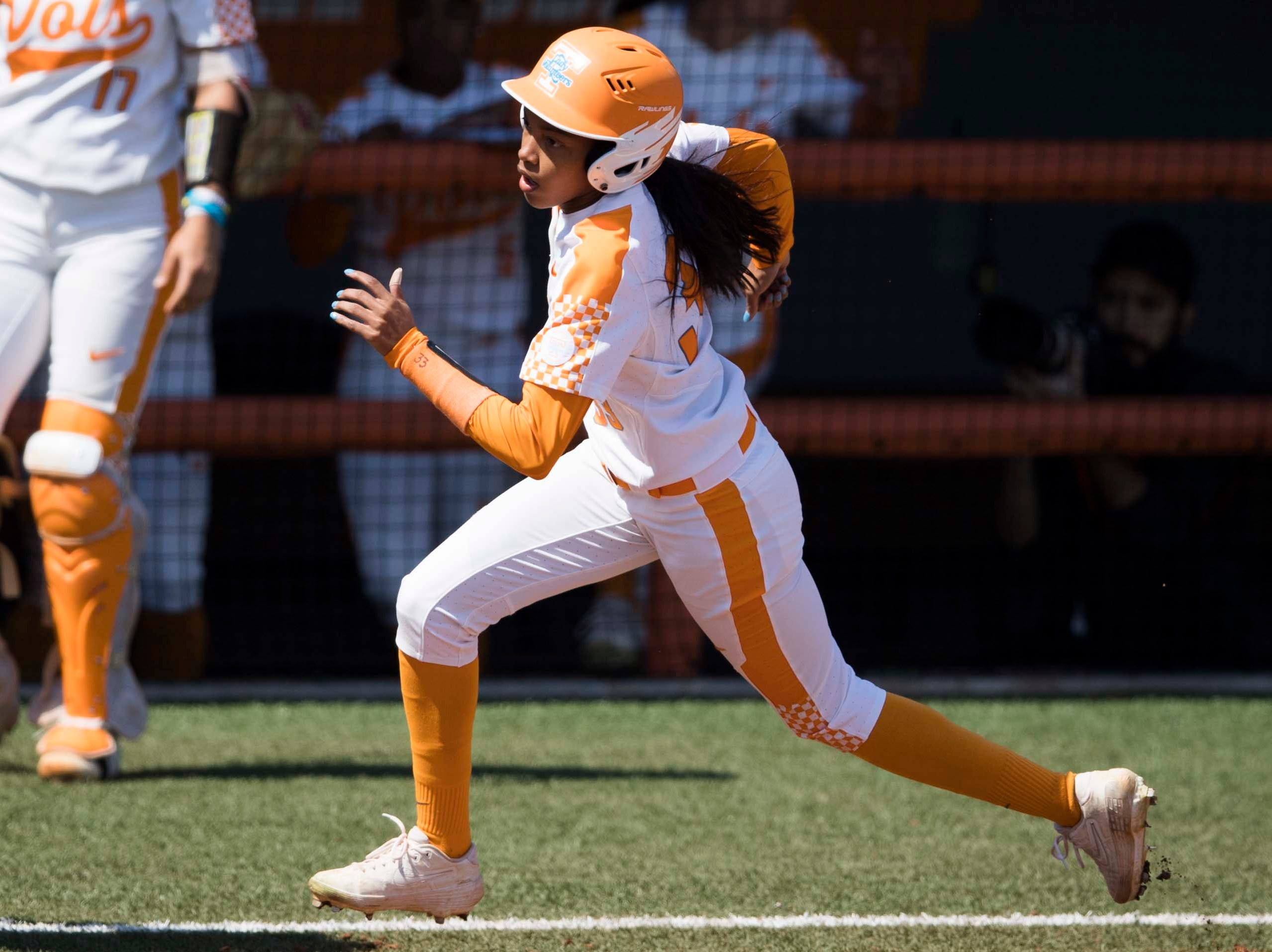 Tennessee outfielder Treasuary Poindexter (33) runs home during a Lady Vols softball game against Arkansas at Sherri Parker Lee stadium on University of Tennessee's campus in Knoxville Sunday, March 24, 2019. The Lady Vols defeated Arkansas.