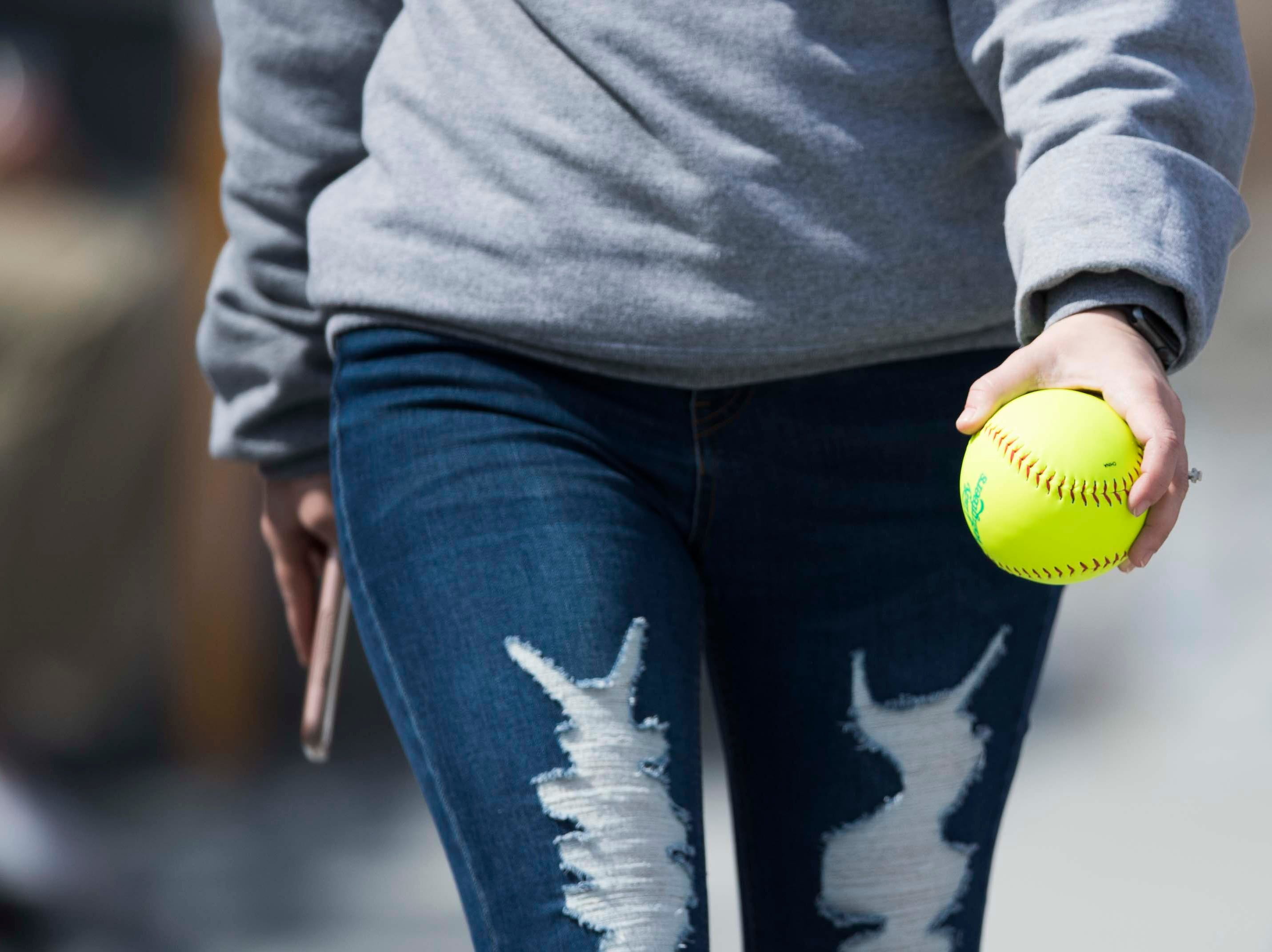A fan holds a Lady Vols softball during a Lady Vols softball game against Arkansas at Sherri Parker Lee stadium on University of Tennessee's campus in Knoxville Sunday, March 24, 2019. The Lady Vols defeated Arkansas.