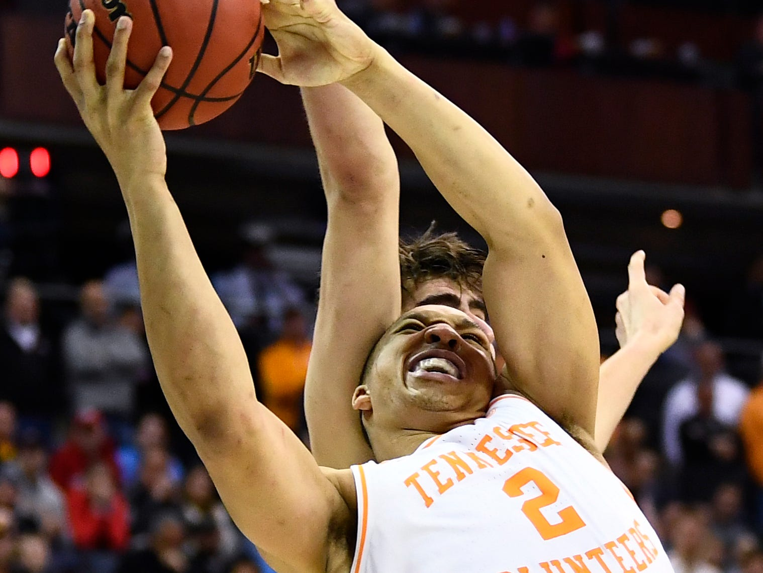 Tennessee forward Grant Williams (2) is fouled by Iowa forward Luka Garza (55) during UT's overtime win in the second round of the NCAA Tournament at Nationwide Arena in Columbus, Ohio, Sunday, March 24, 2019.