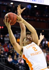 Tennessee forward Grant Williams (2) is fouled by Iowa forward Luka Garza (55) during UT's overtime win Sunday.