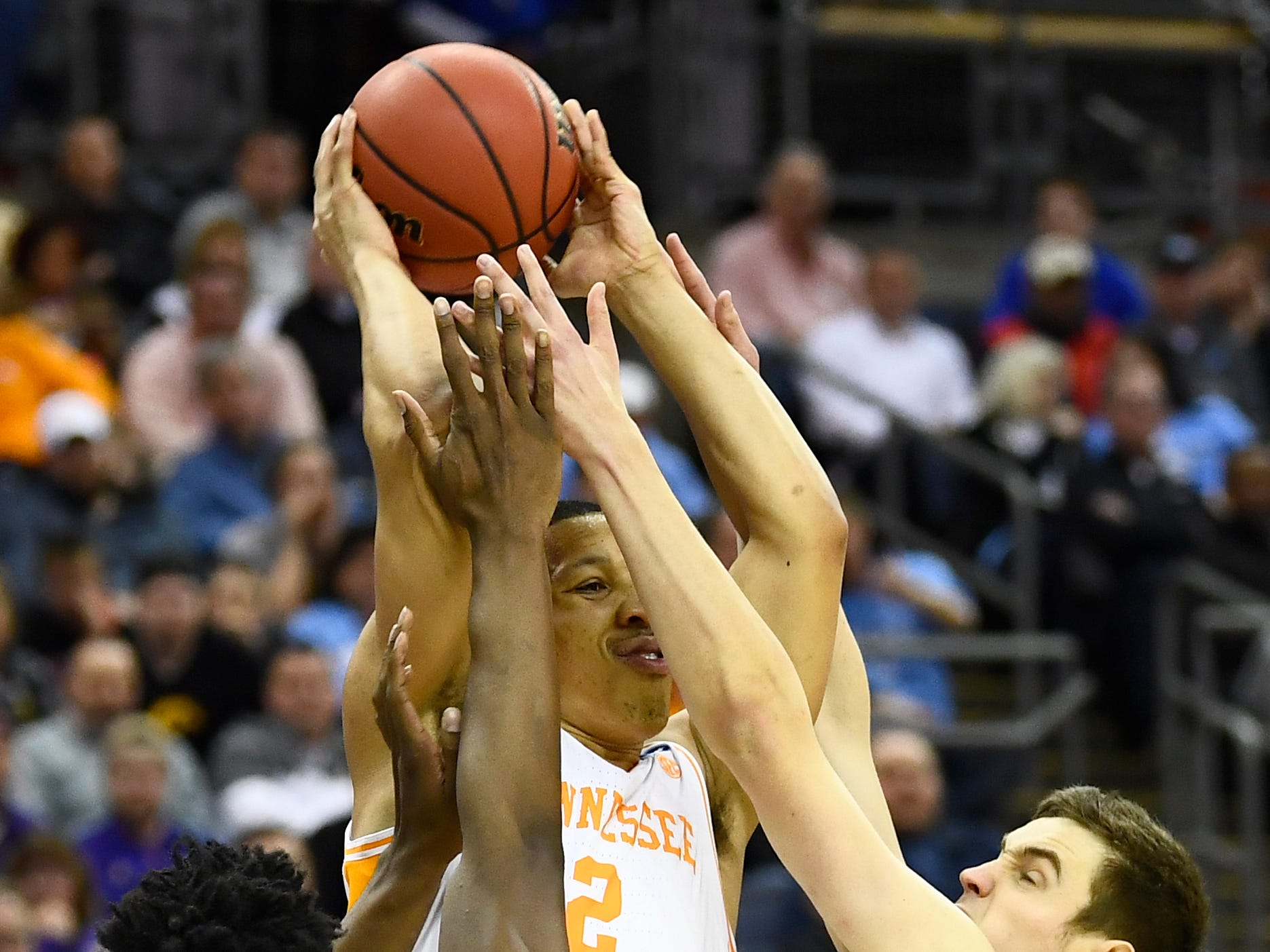 Tennessee forward Grant Williams (2) tries to pass the ball off surrounded by Iowa defenders during the second half in the second round of the NCAA Tournament at Nationwide Arena in Columbus, Ohio, Sunday, March 24, 2019.