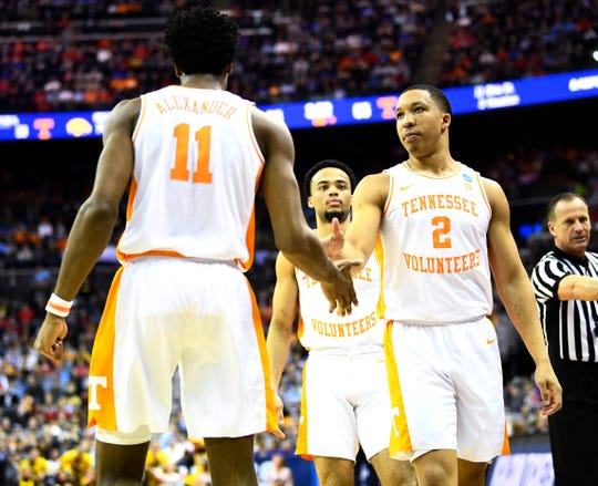 Tennessee forward Grant Williams (2) high fives Tennessee guard Lamonte Turner (1) during the team's overtime win over the Iowa Hawkeyes in the second round of the NCAA Tournament at Nationwide Arena in Columbus, Ohio, Sunday, March 24, 2019.