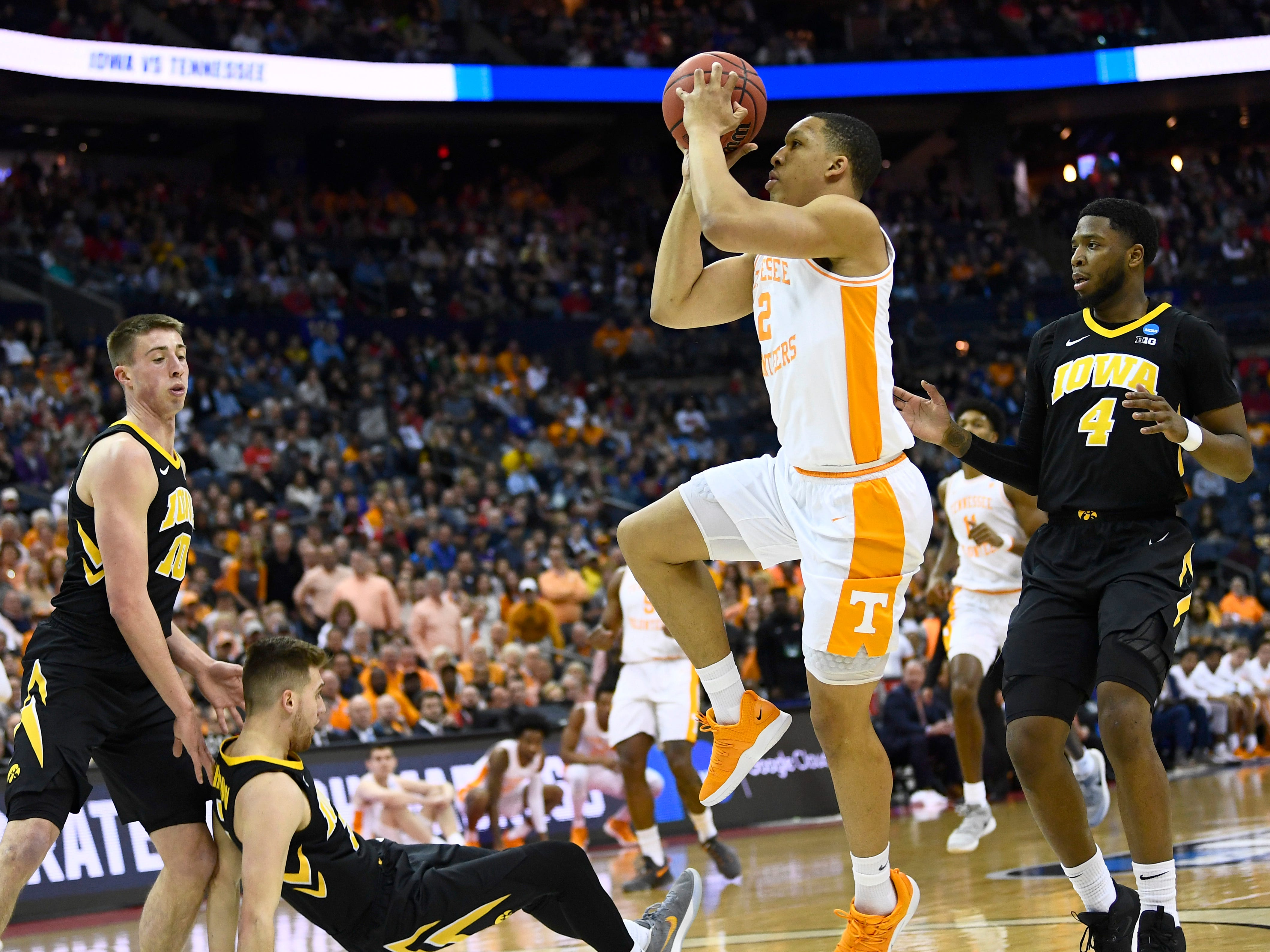 Tennessee forward Grant Williams (2) shoots while being fouled by Iowa guard Jordan Bohannon (3) during the first half of the second-round game of the NCAA Tournament at Nationwide Arena in Columbus, Ohio, Sunday, March 24, 2019.