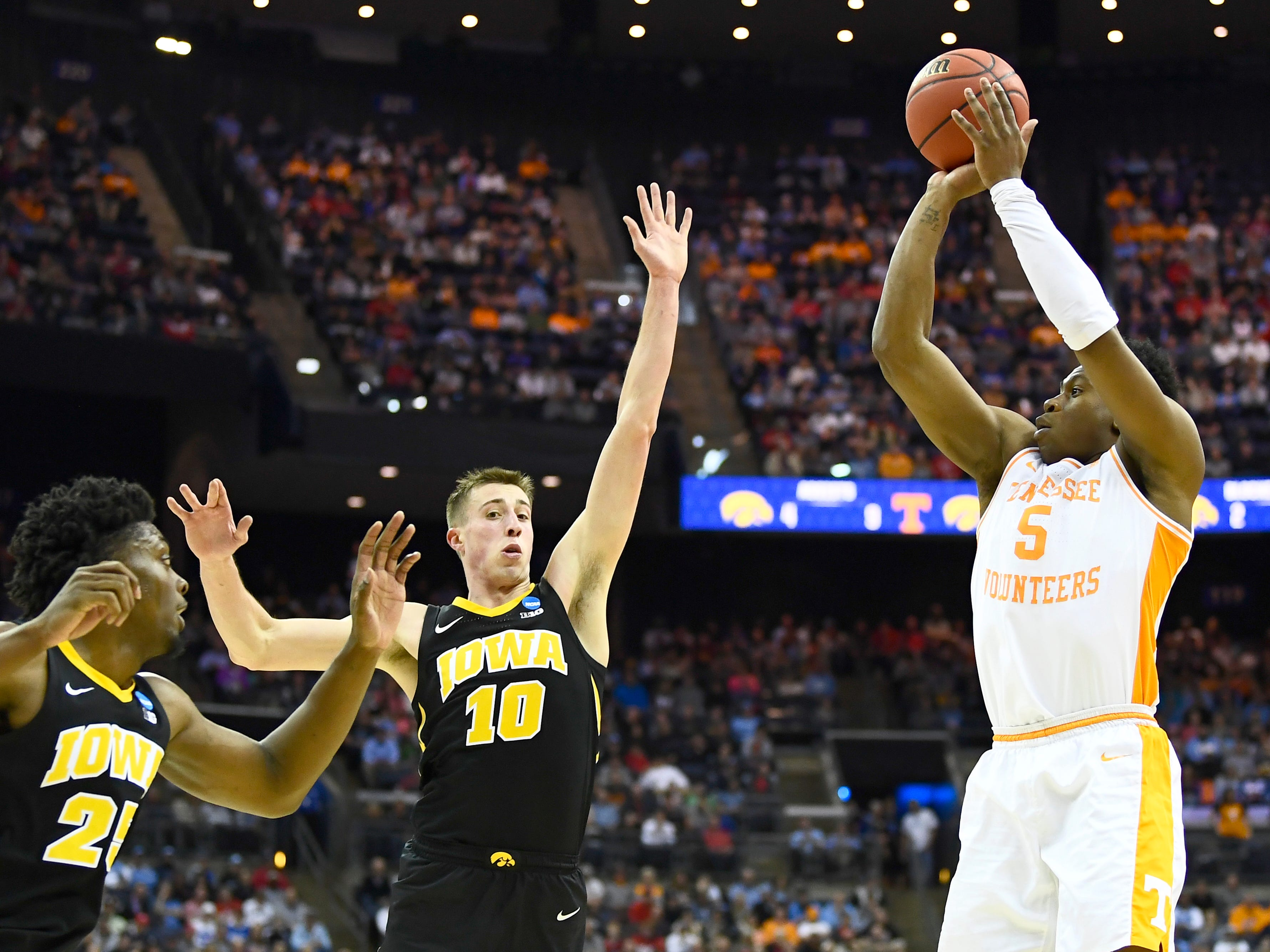 Tennessee guard Admiral Schofield (5) attempts a three-pointer over Iowa forward Tyler Cook (25) and Iowa guard Joe Wieskamp (10) during the second half in the second-round game of the NCAA Tournament at Nationwide Arena in Columbus, Ohio, Sunday, March 24, 2019.