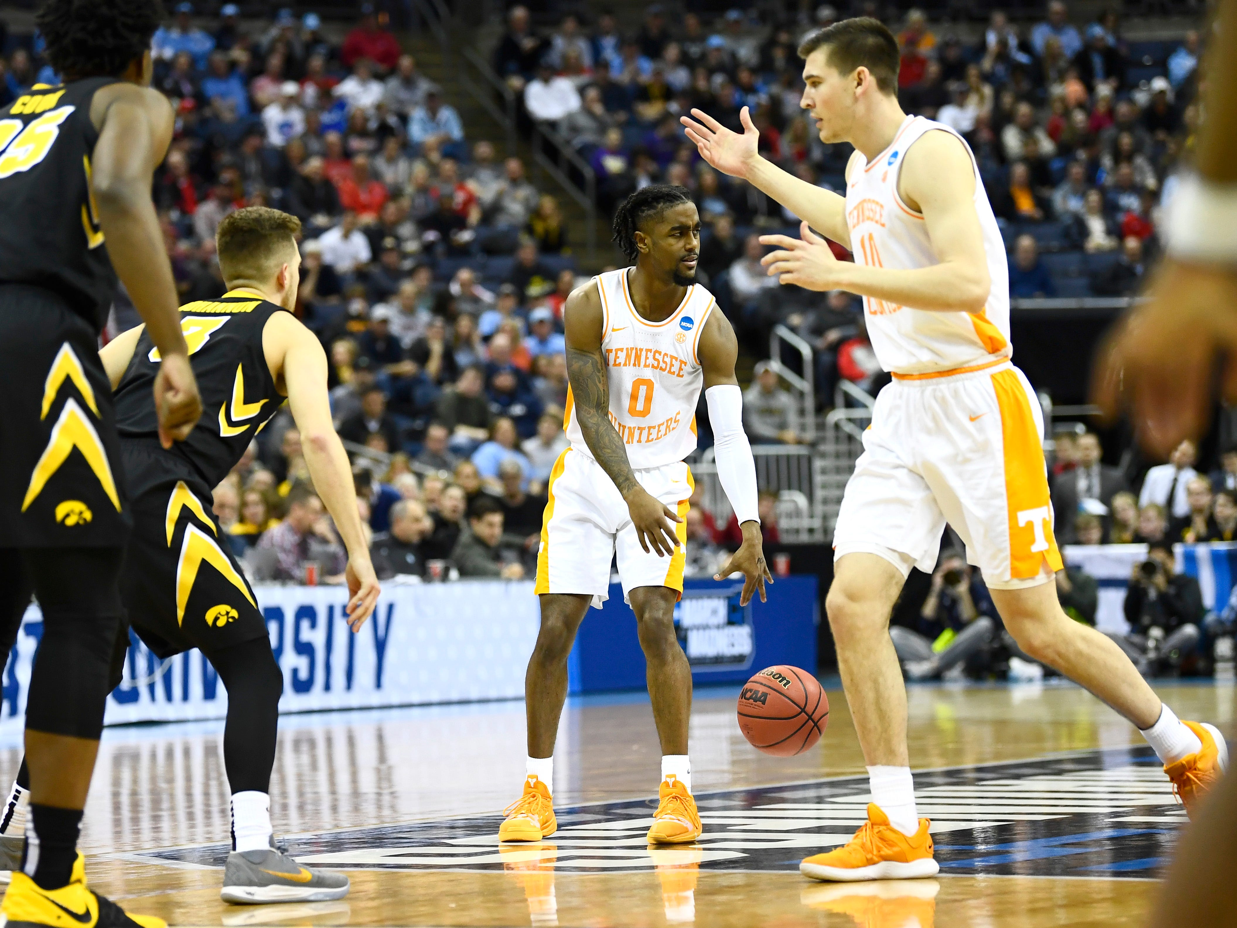 Tennessee guard Jordan Bone (0) and forward John Fulkerson (10) look in disbelief after Fulkerson was pushed off by Iowa guard Jordan Bohannon (3) during the second half of the second-round game of the NCAA Tournament at Nationwide Arena in Columbus, Ohio, Sunday, March 24, 2019.