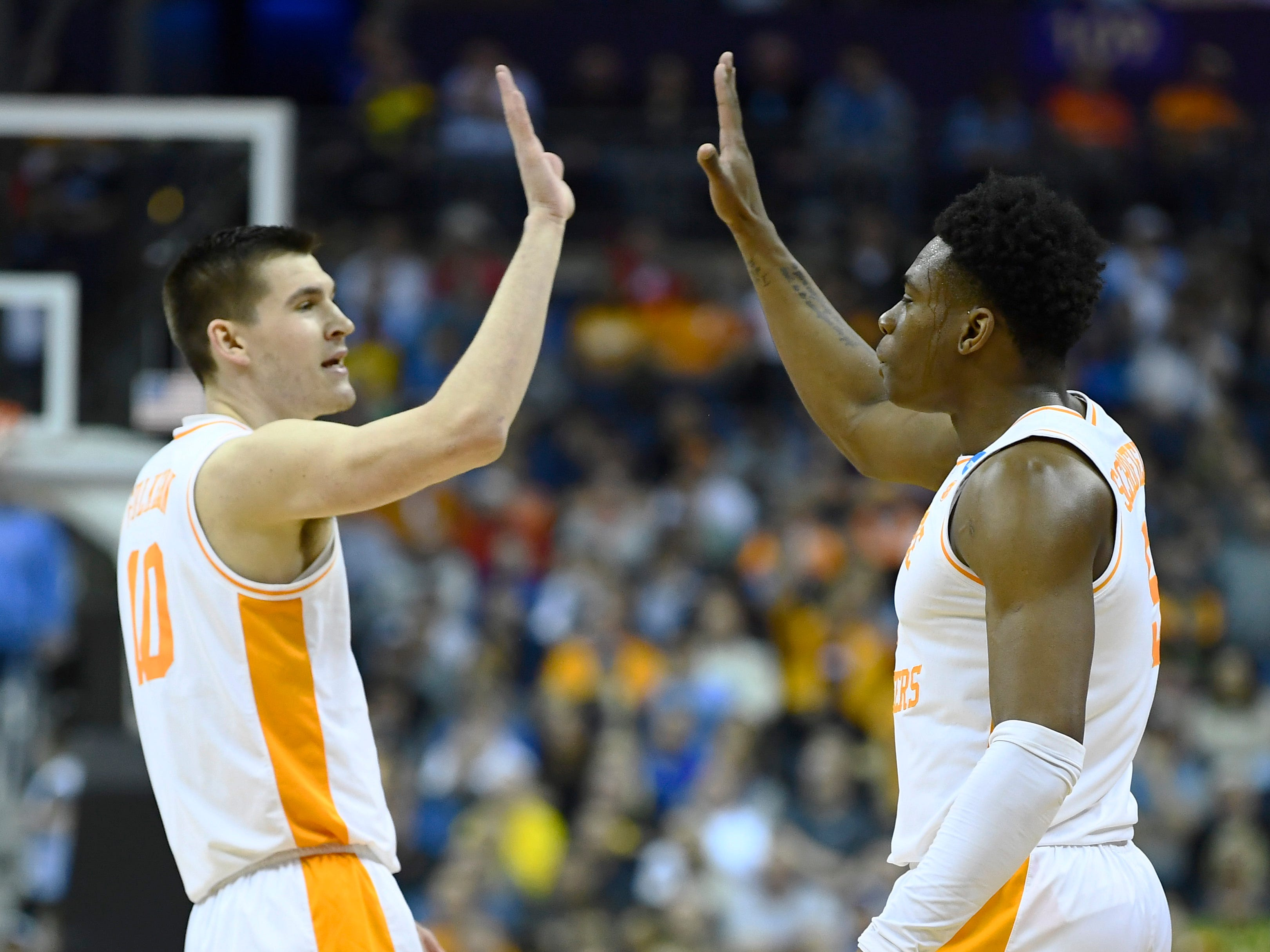 Tennessee forward John Fulkerson (10) and guard Admiral Schofield (5) high five during the first half of the Tennessee VolunteersÕ basketball game against the Iowa Hawkeyes in the second round of the NCAA Tournament at Nationwide Arena in Columbus, Ohio, Sunday, March 24, 2019.