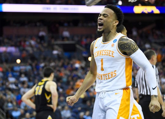 Tennessee guard Lamonte Turner (1) celebrates a foul against Iowa during the first half Sunday.