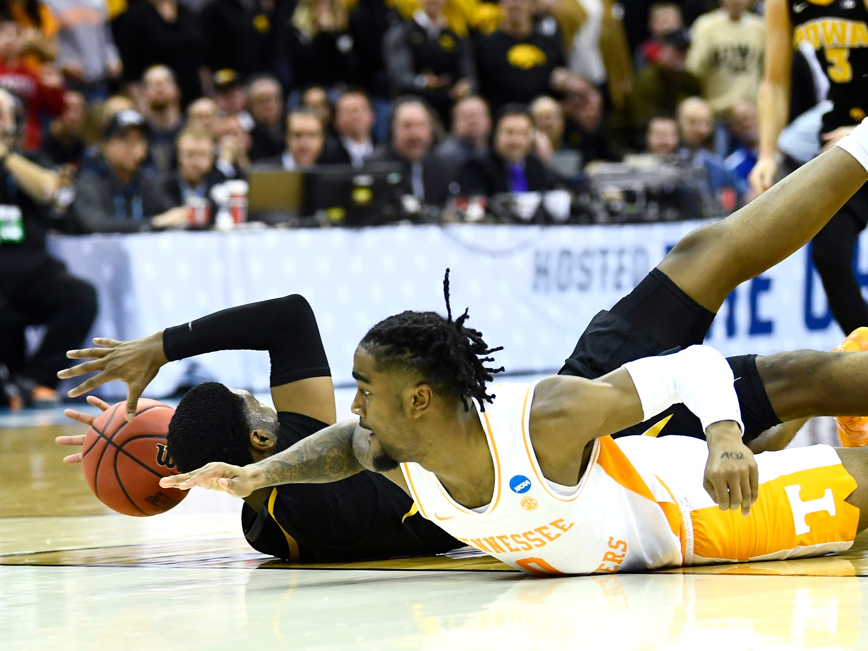 Tennessee guard Jordan Bone (0) and Iowa guard Isaiah Moss (4) battle for a loose ball during UT's overtime win in the second round of the NCAA Tournament at Nationwide Arena in Columbus, Ohio, Sunday, March 24, 2019.