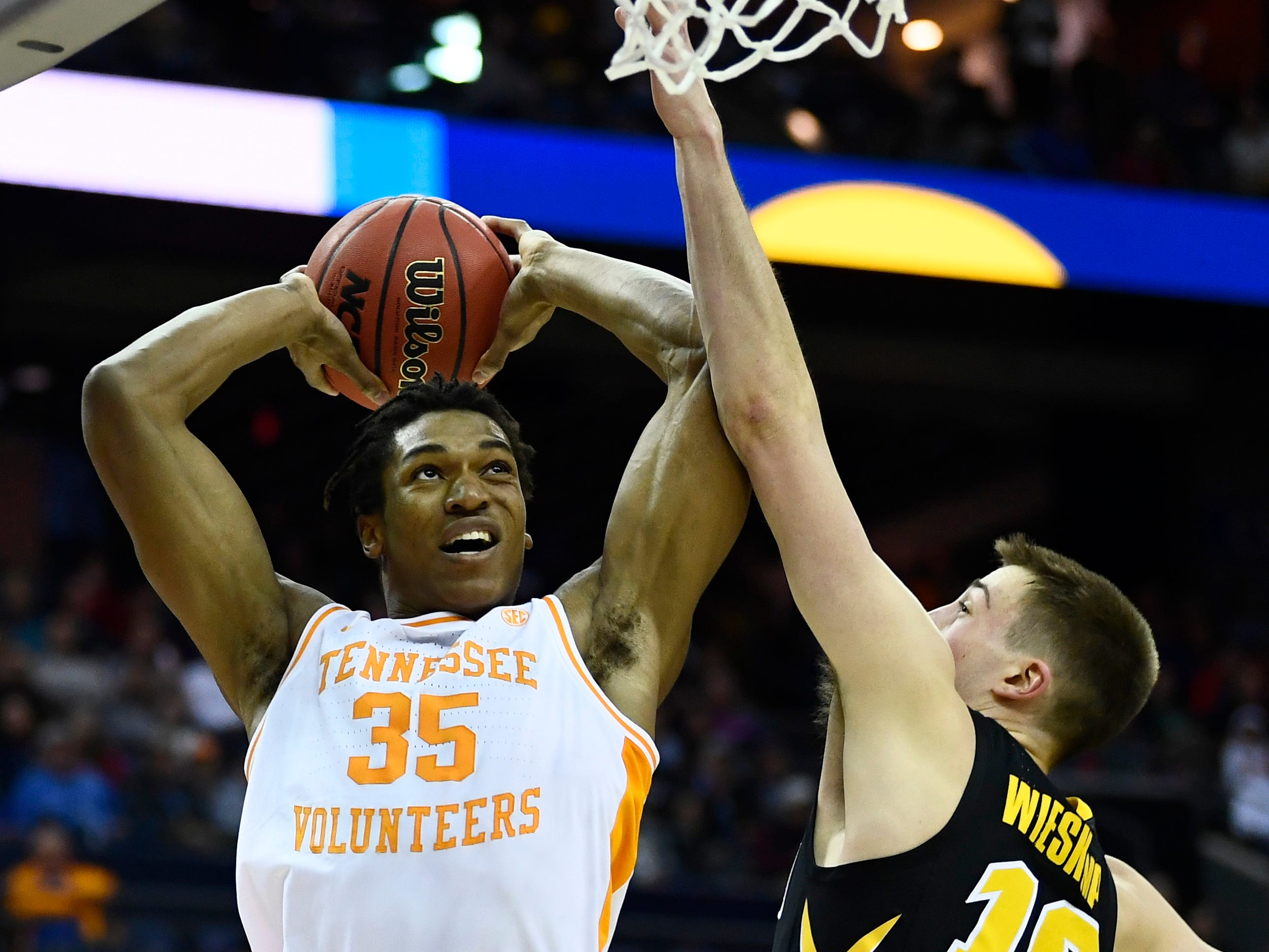 Tennessee guard/forward Yves Pons (35) takes a shot over Iowa guard Joe Wieskamp (10) during the first half of the game in the second round of the NCAA Tournament at Nationwide Arena in Columbus, Ohio, Sunday, March 24, 2019.