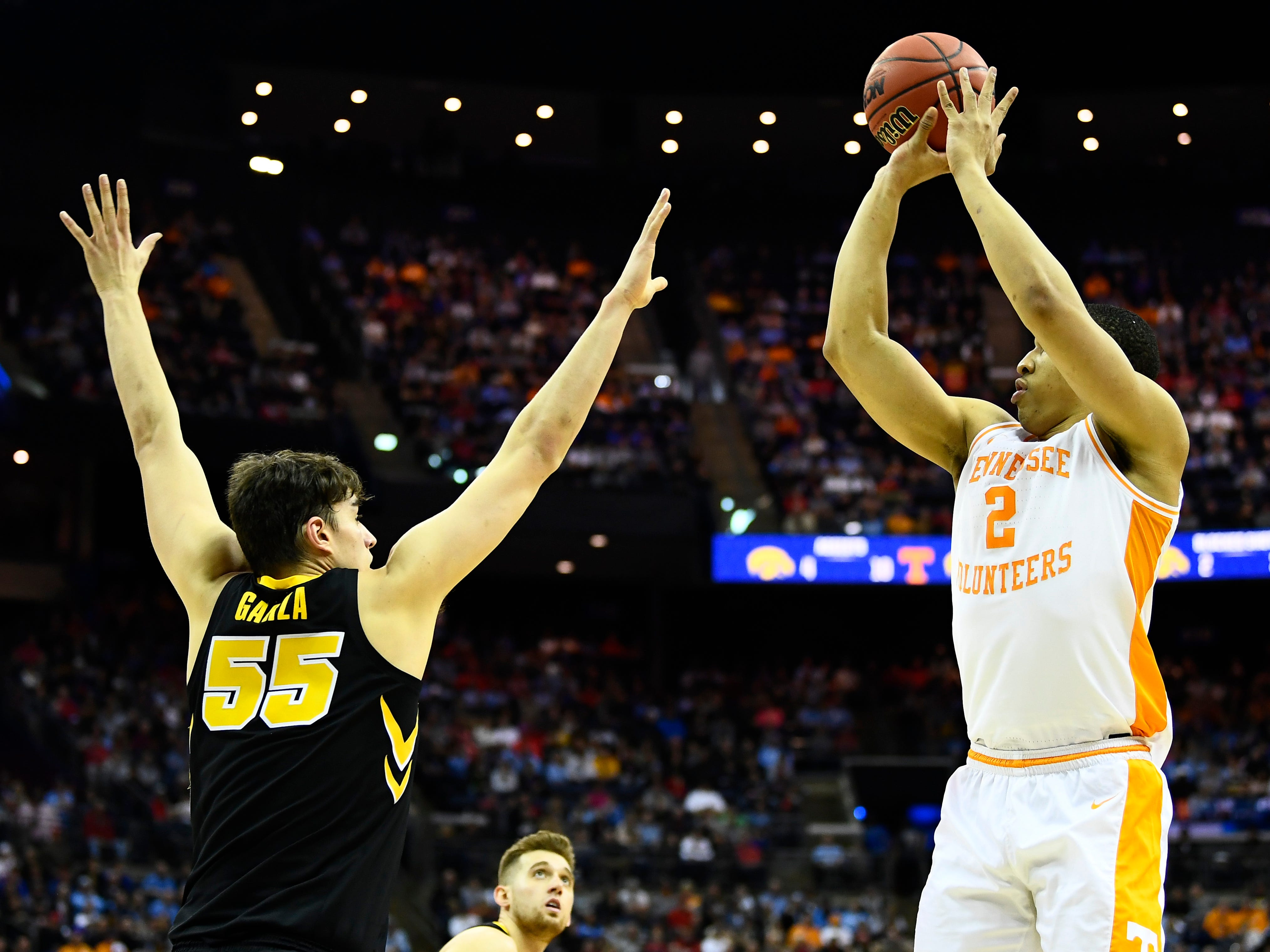 Tennessee forward Grant Williams (2) shoots over Iowa forward Luka Garza (55) during the secod half in the second round of the NCAA Tournament at Nationwide Arena in Columbus, Ohio, Sunday, March 24, 2019.