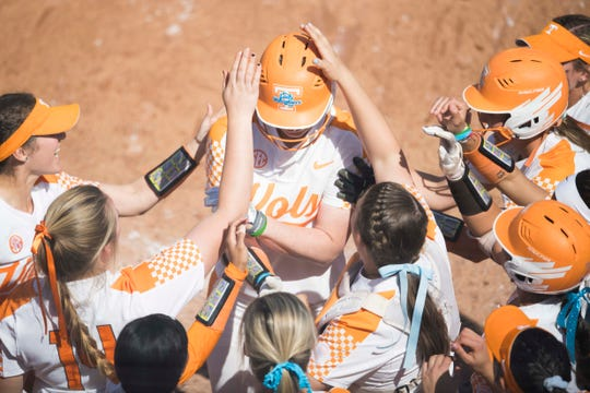 Tennessee outfielder Haley Bearden (11) is congratulated my teammates on her homer during a Lady Vols softball game against Arkansas at Sherri Parker Lee stadium on University of Tennessee's campus in Knoxville Sunday, March 24, 2019. The Lady Vols defeated Arkansas.