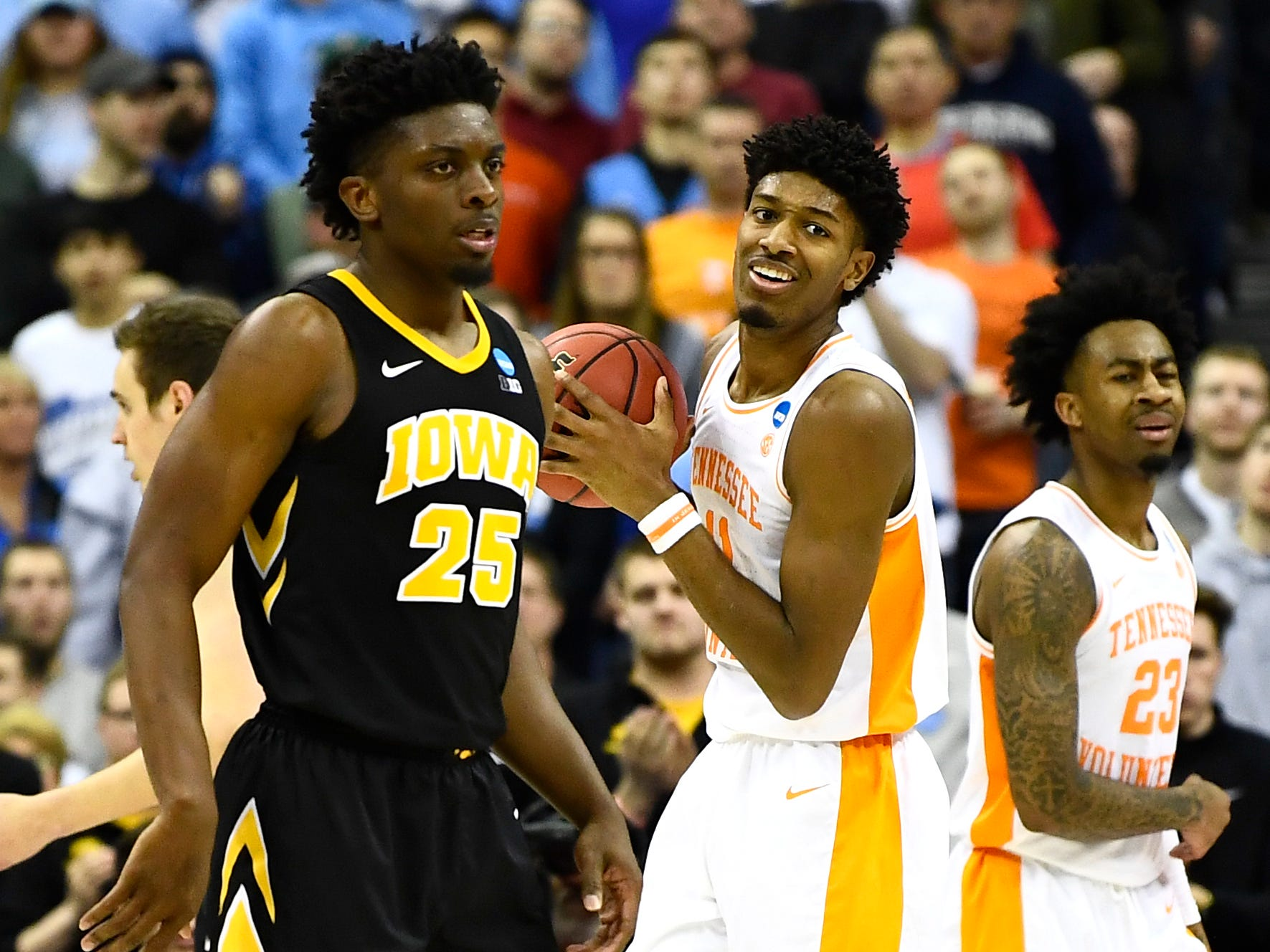 Tennessee forward Kyle Alexander (11) and Tennessee guard Brad Woodson (12) react to a foul call during the overtimewin over the Iowa Hawkeyes in the second round of the NCAA Tournament at Nationwide Arena in Columbus, Ohio, Sunday, March 24, 2019.