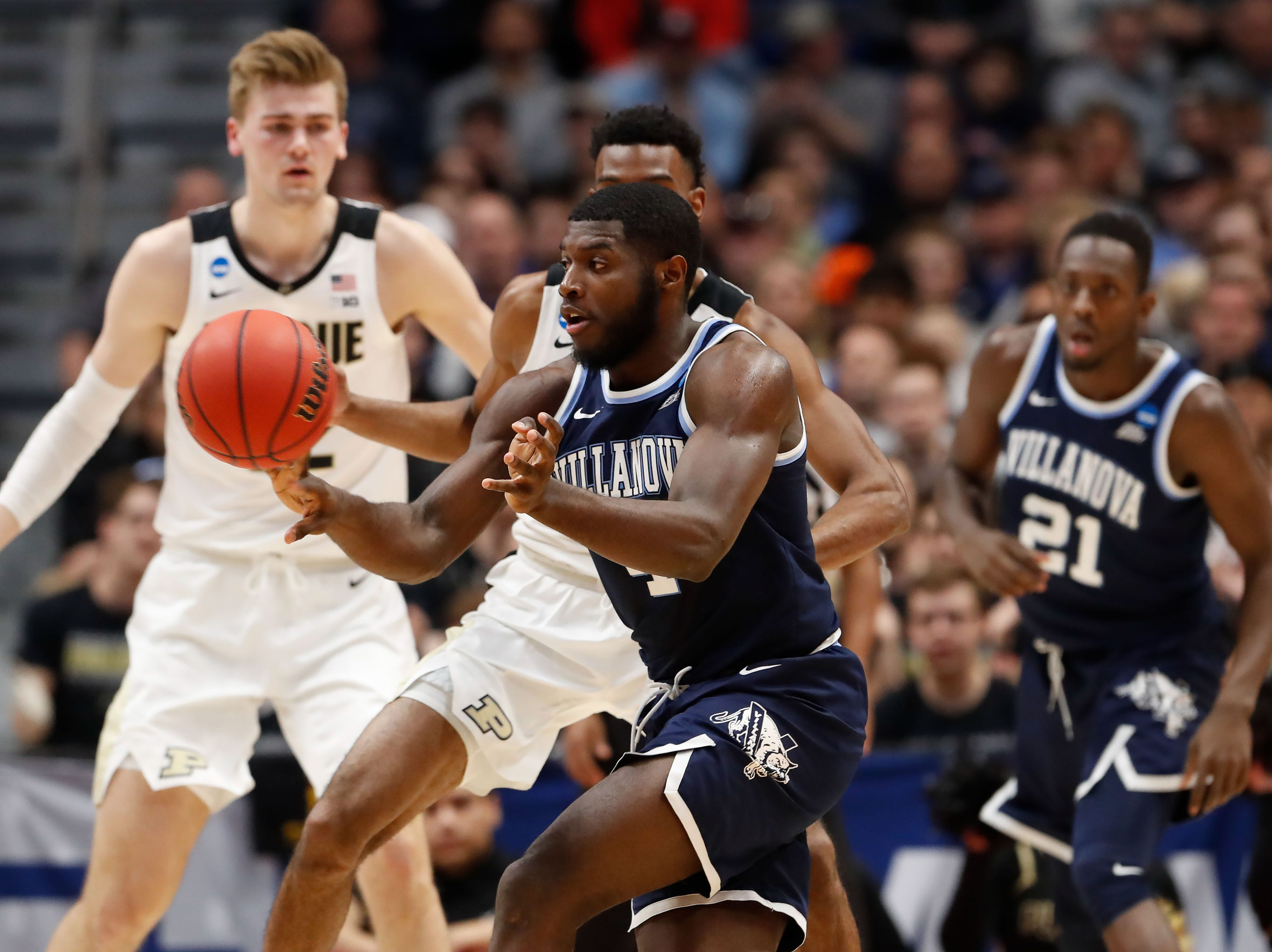 Mar 23, 2019; Hartford, CT, USA; Villanova Wildcats forward Eric Paschall (4) passes the ball during the first half of a game against the Purdue Boilermakers in the second round of the 2019 NCAA Tournament at XL Center. Mandatory Credit: David Butler II-USA TODAY Sports