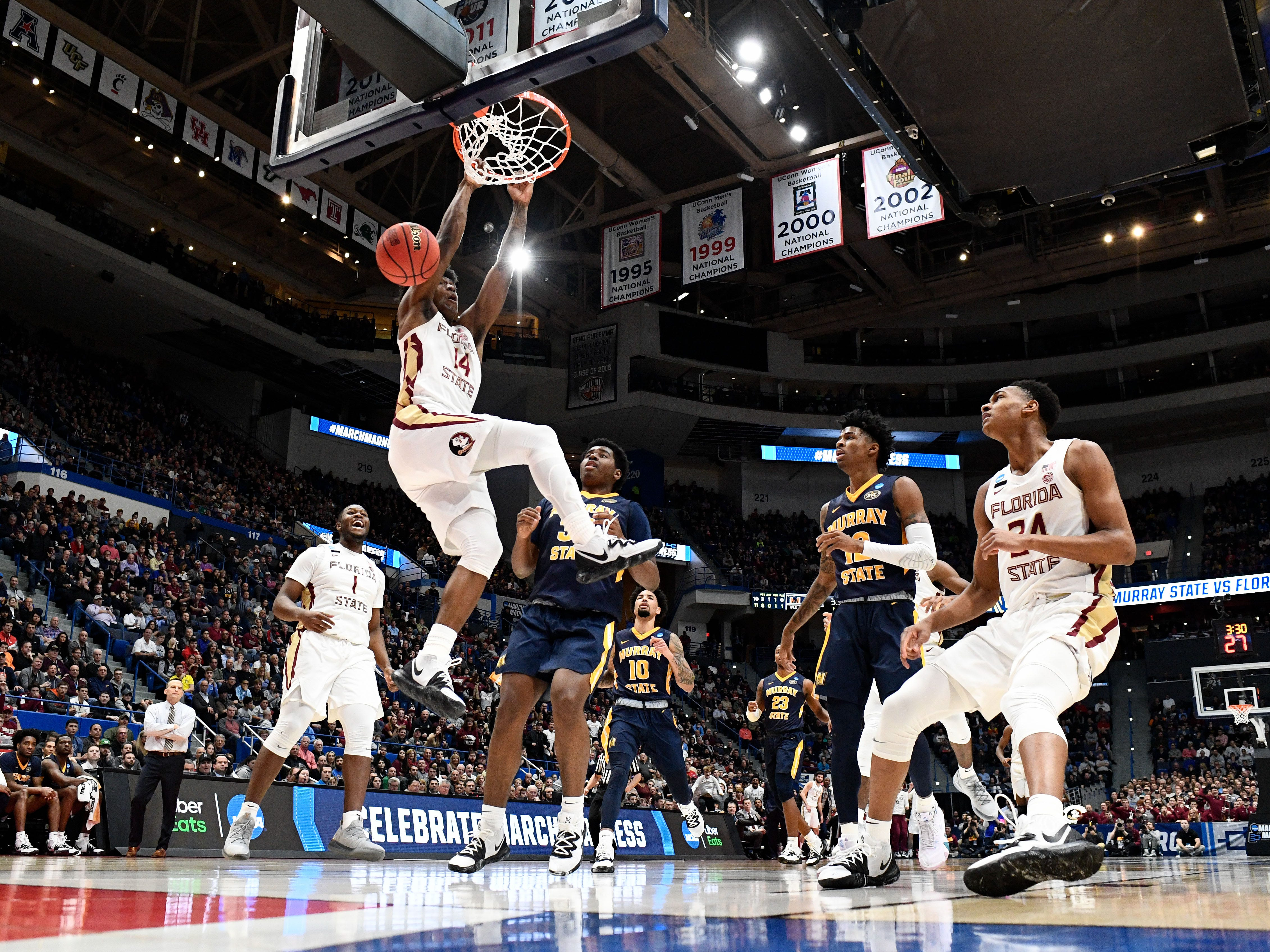 Mar 23, 2019; Hartford, CT, USA; Florida State Seminoles guard Terance Mann (14) dunks and scores against the Murray State Racers during the first half of a game in the second round of the 2019 NCAA Tournament at XL Center. Mandatory Credit: Robert Deutsch-USA TODAY Sports