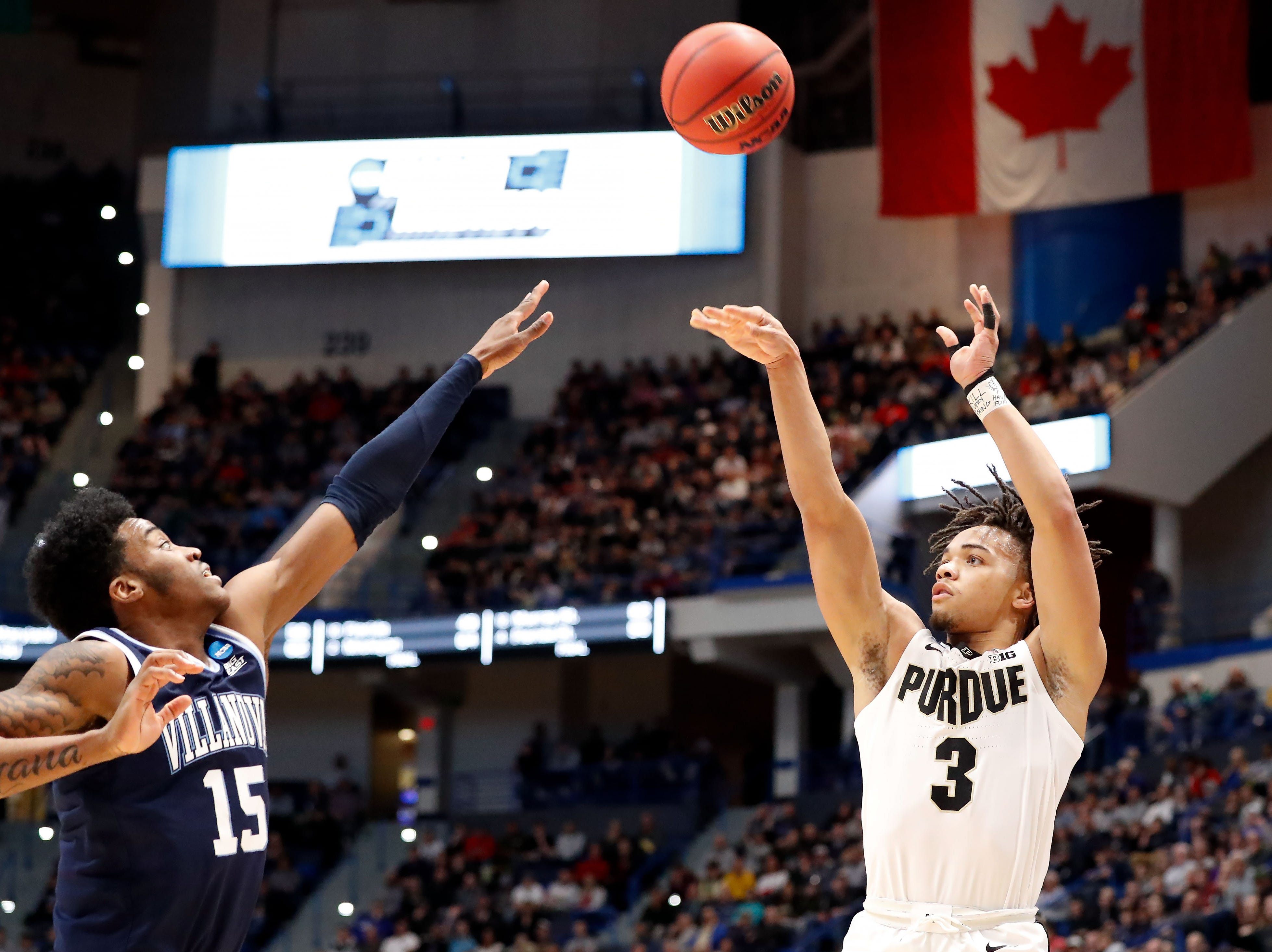 Mar 23, 2019; Hartford, CT, USA; Purdue Boilermakers guard Carsen Edwards (3) attempt a shot over Villanova Wildcats forward Saddiq Bey (15) during the first half of a game in the second round of the 2019 NCAA Tournament at XL Center. Mandatory Credit: David Butler II-USA TODAY Sports