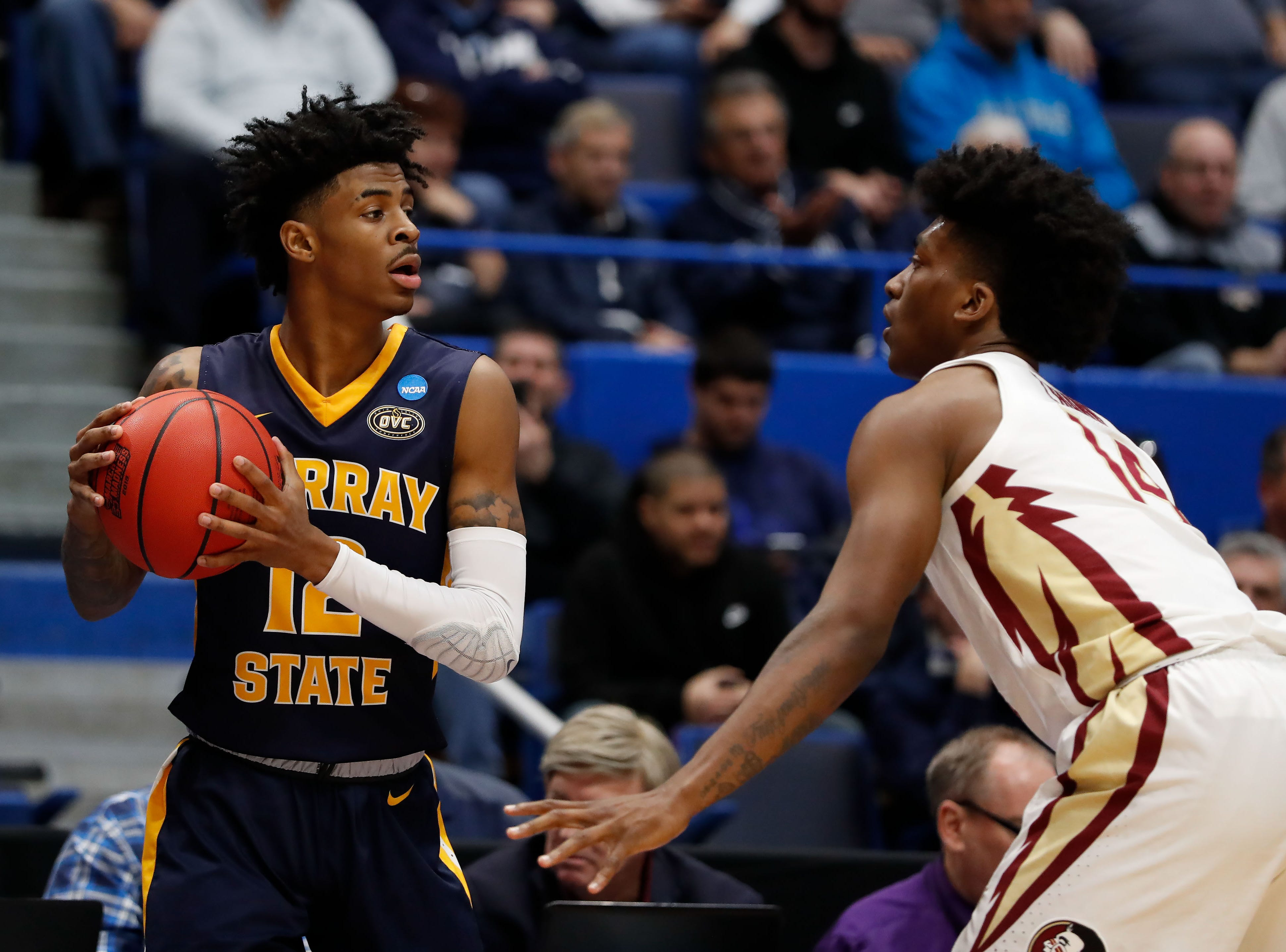 Mar 23, 2019; Hartford, CT, USA; Murray State Racers guard Ja Morant (12) looks to pass around Florida State Seminoles guard Terance Mann (14) during the first half of a game in the second round of the 2019 NCAA Tournament at XL Center. Mandatory Credit: David Butler II-USA TODAY Sports
