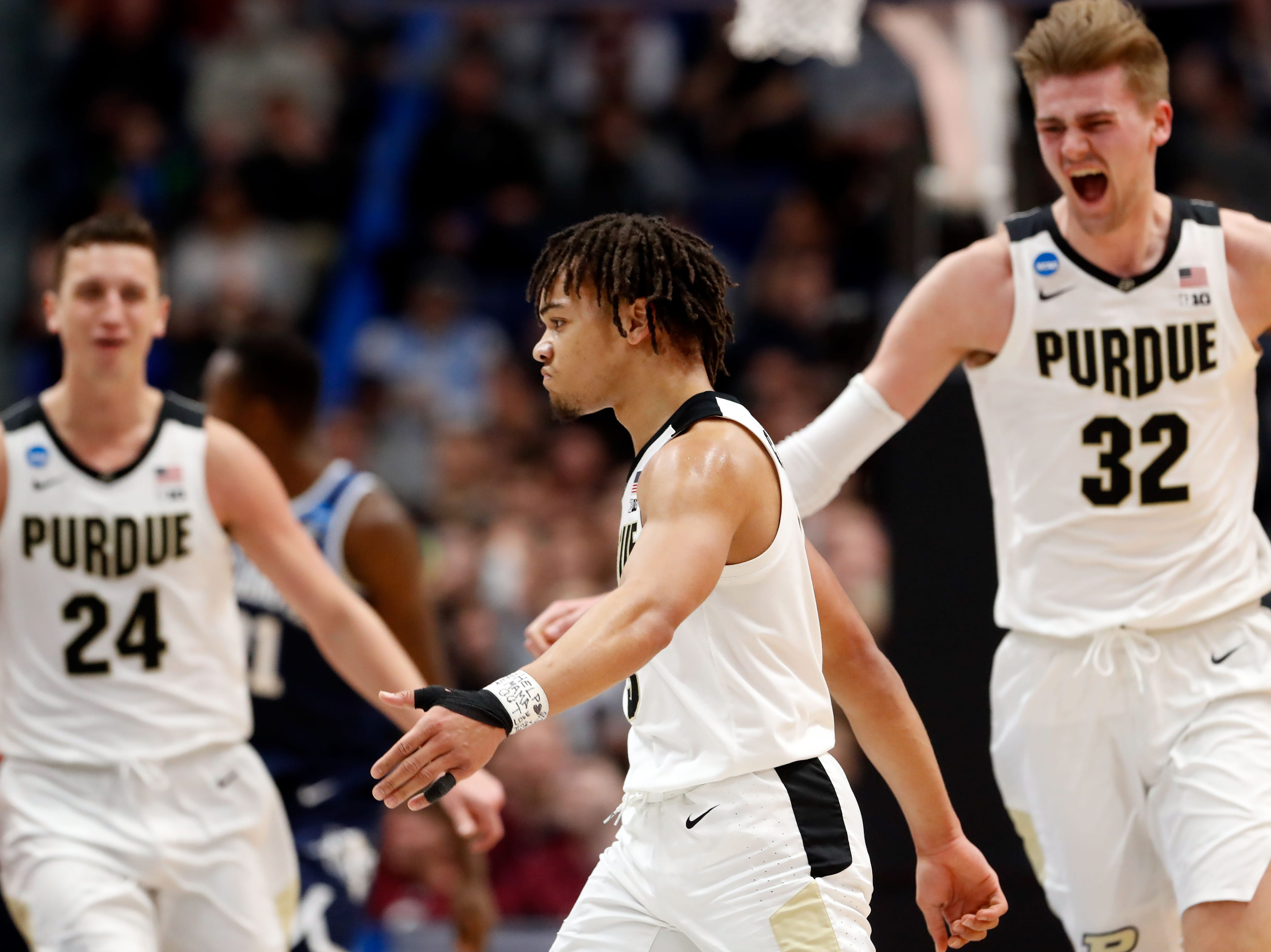 Mar 23, 2019; Hartford, CT, USA; Purdue Boilermakers guard Carsen Edwards (3), forward Grady Eifert (24), and center Matt Haarms (32) react after a score against the Villanova Wildcats during the second half of a game in the second round of the 2019 NCAA Tournament at XL Center. Mandatory Credit: David Butler II-USA TODAY Sports